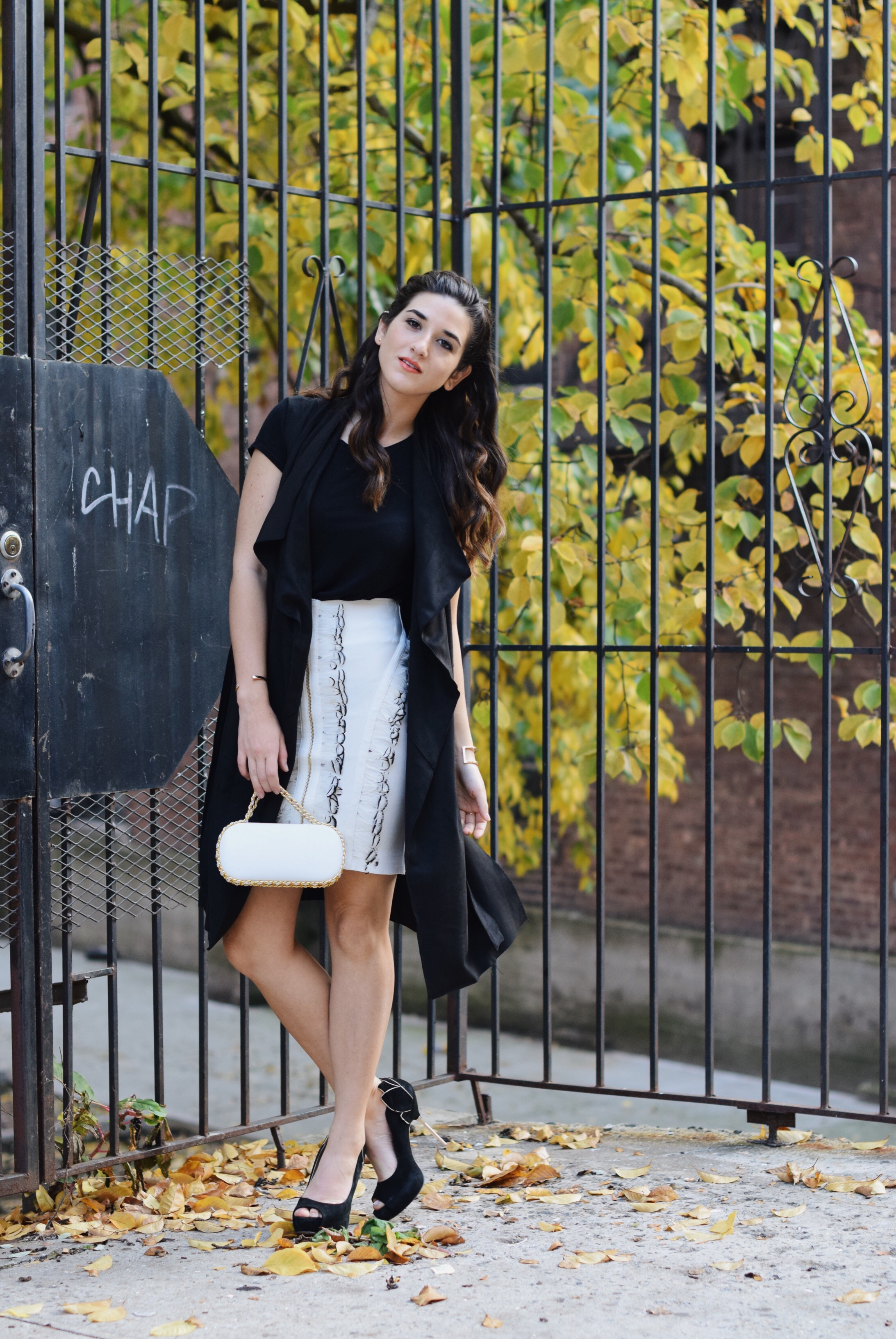 White Feather Skirt Long Black Vest Wow Couture Louboutins & Love Fashion Blog Esther Santer NYC Street Style Blogger Photoshoot Hairstyle Inspo Heels Gold Black Tee Zara Outfit OOTD Beauty Braid Winter Fall Girl Women Model Erin Dana White Minaudiere.JPG