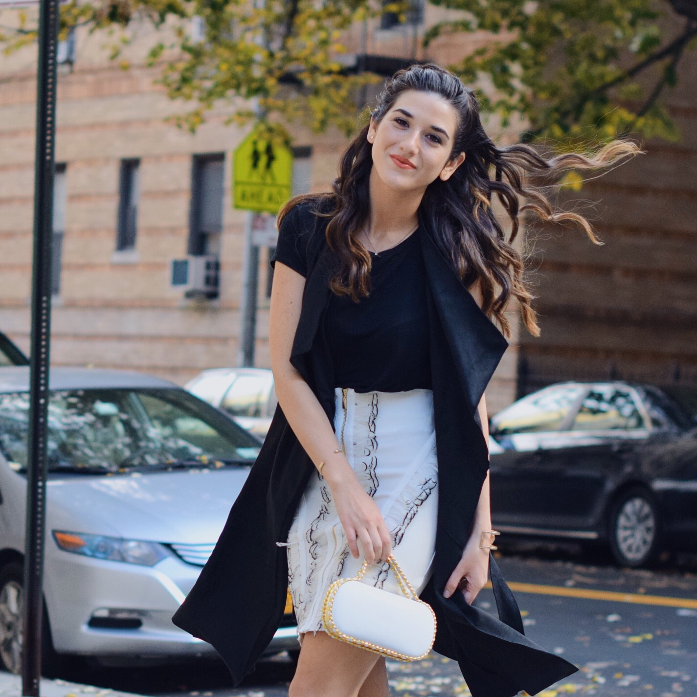 White Feather Skirt Long Black Vest Wow Couture Louboutins & Love Fashion Blog Esther Santer NYC Street Style Blogger Photoshoot Hairstyle Inspo Heels Gold Black Tee Zara Outfit OOTD Beauty Girl Women Model Fall Winter Look Erin Dana White Minaudiere.JPG