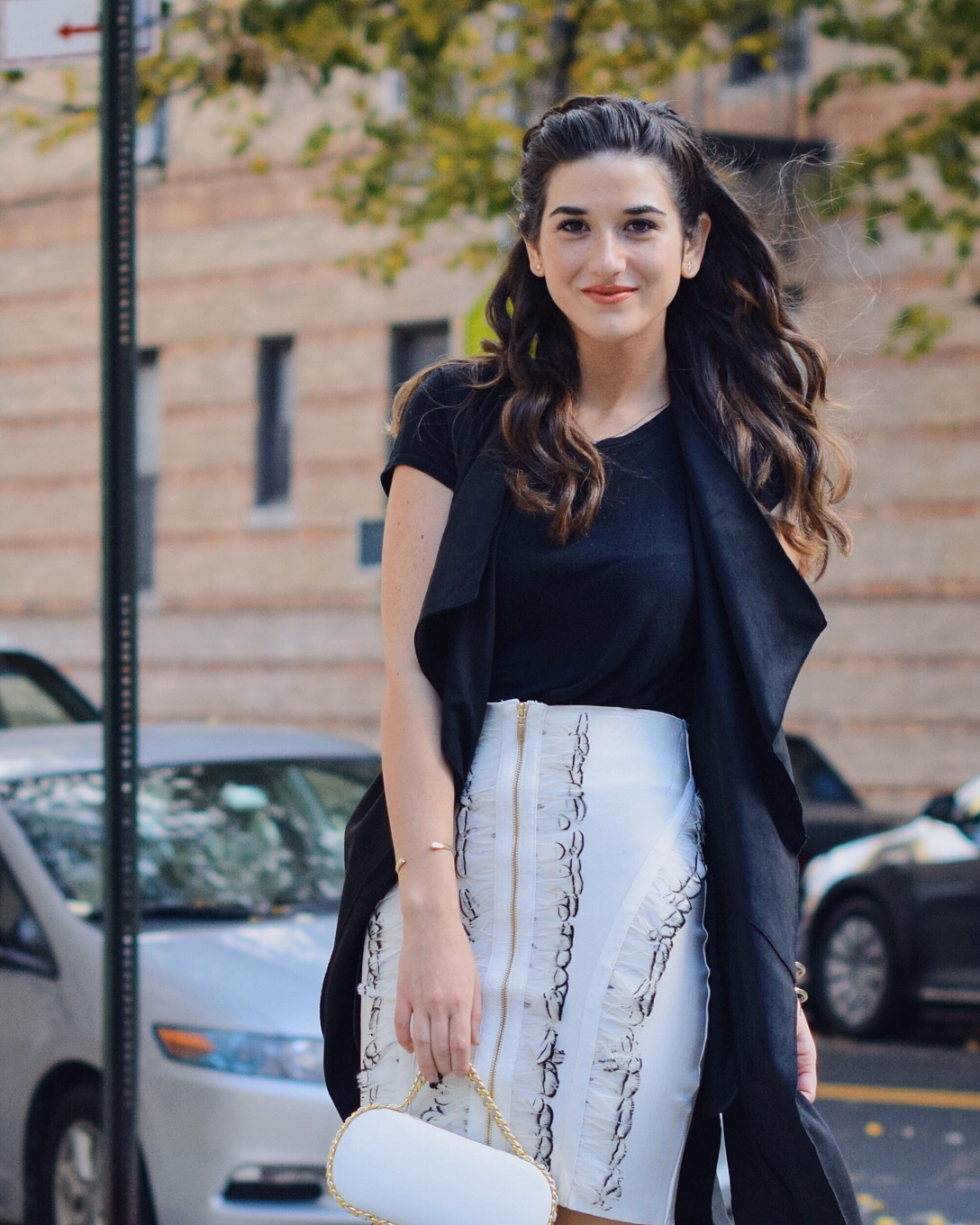 White Feather Skirt Long Black Vest Wow Couture Louboutins & Love Fashion Blog Esther Santer NYC Street Style Blogger Photoshoot Hairstyle Inspo Heels Gold Black Tee Zara Outfit OOTD Beauty Winter Fall Braid Girl Women Model Erin Dana White Minaudiere.JPG