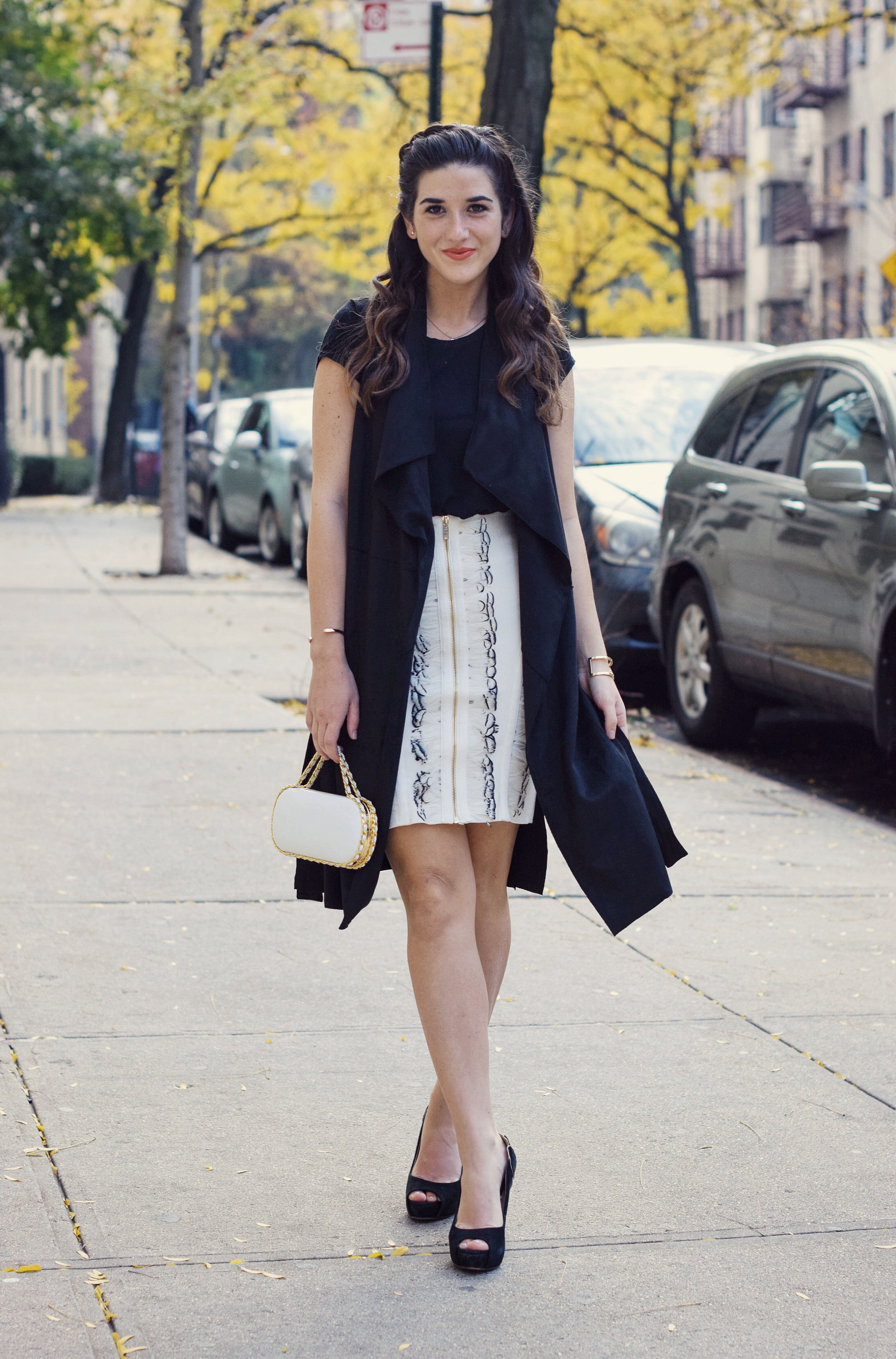 White Feather Skirt Long Black Vest Wow Couture Louboutins & Love Fashion Blog Esther Santer NYC Street Style Blogger Photoshoot Hairstyle Inspo Heels Gold Black Tee Zara Outfit OOTD Beauty Winter Fall Look Girl Women Model Erin Dana White Minaudiere.JPG