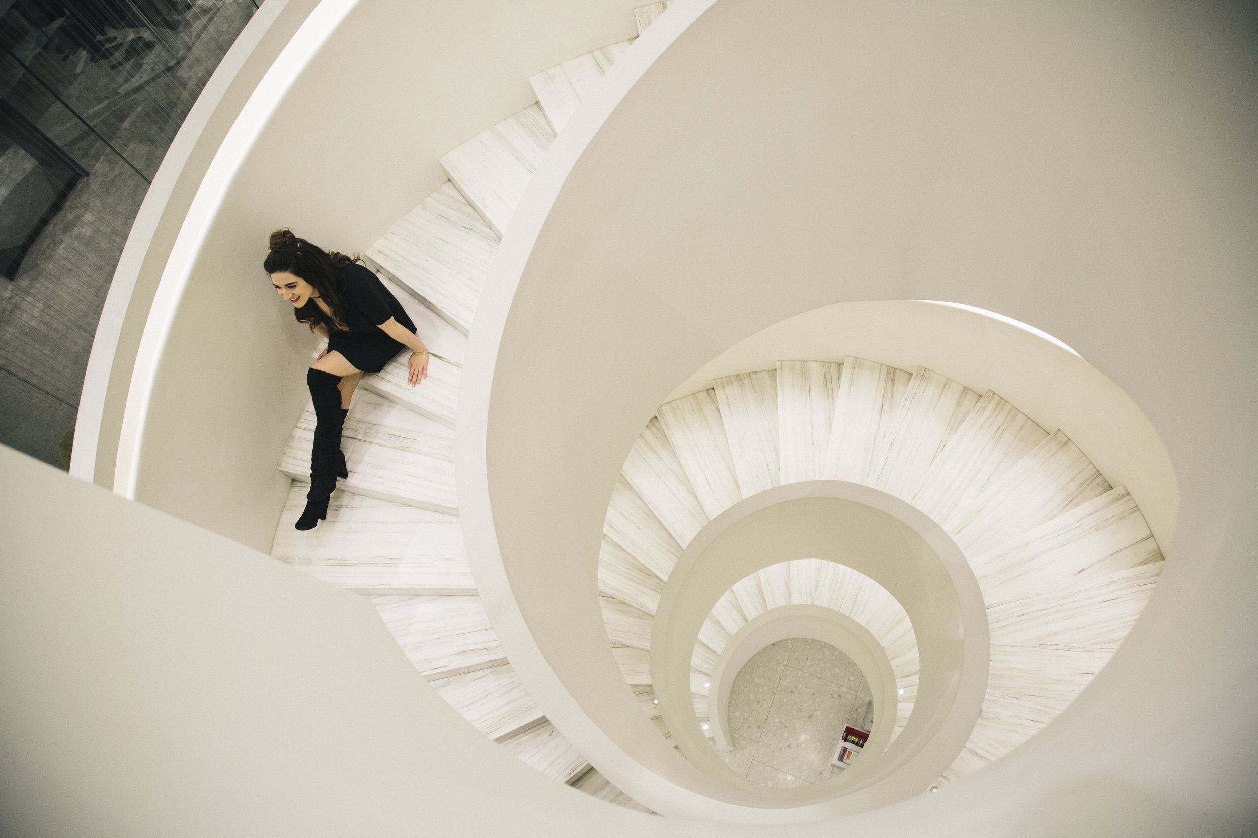 Down The Rabbit Hole All Black Look Louboutins & Love Fashion Blog Esther Santer NYC Street Style Blogger Outfit OOTD Trendy Barneys White Spiral Staircase Beautiful Photoshoot Boots Ivanka Trump Nordstrom Shopping Wear  Hair Topknot Girl Women Chic.jpg