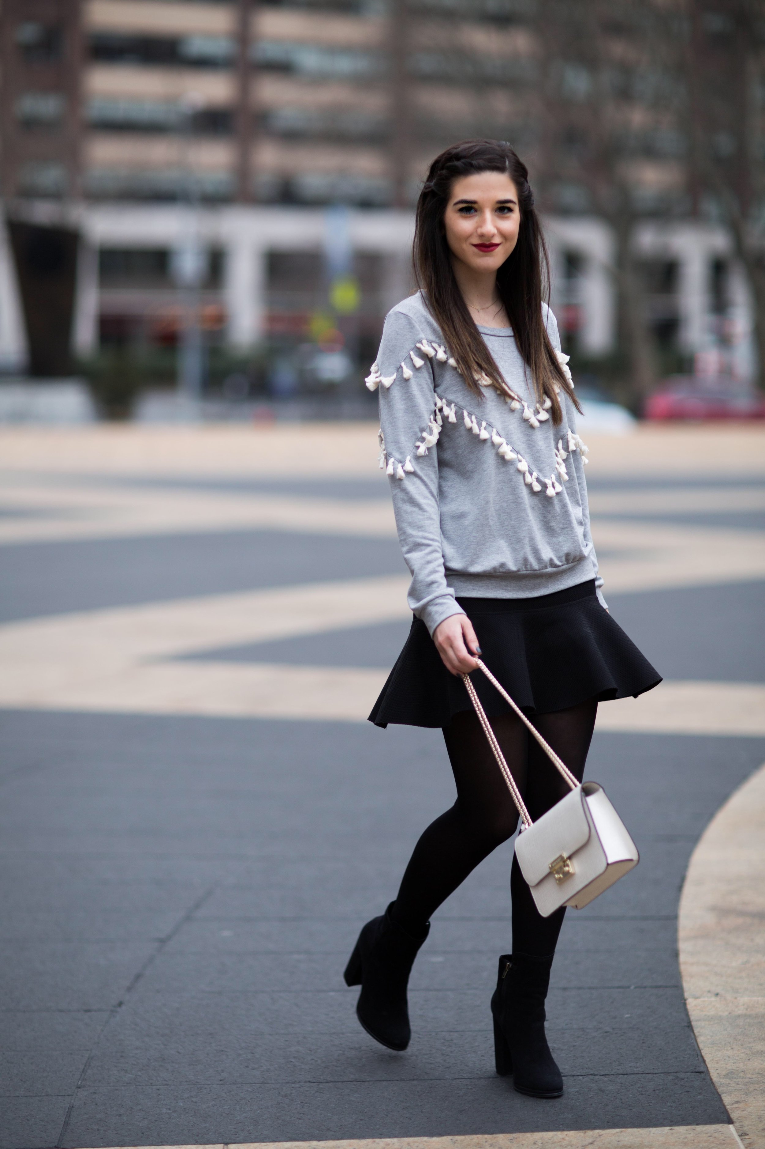 Grey Tassel Sweatshirt Everything You Wanted To Know About Blog Interns Esther Santer Fashion Blog NYC Street Style Blogger Outfit OOTD Trendy Henri Bendel Waldorf Party Bag Black Mini Skirt Booties Shoes Cozy Tights Photoshoot Model Girl Women  Hair.jpg