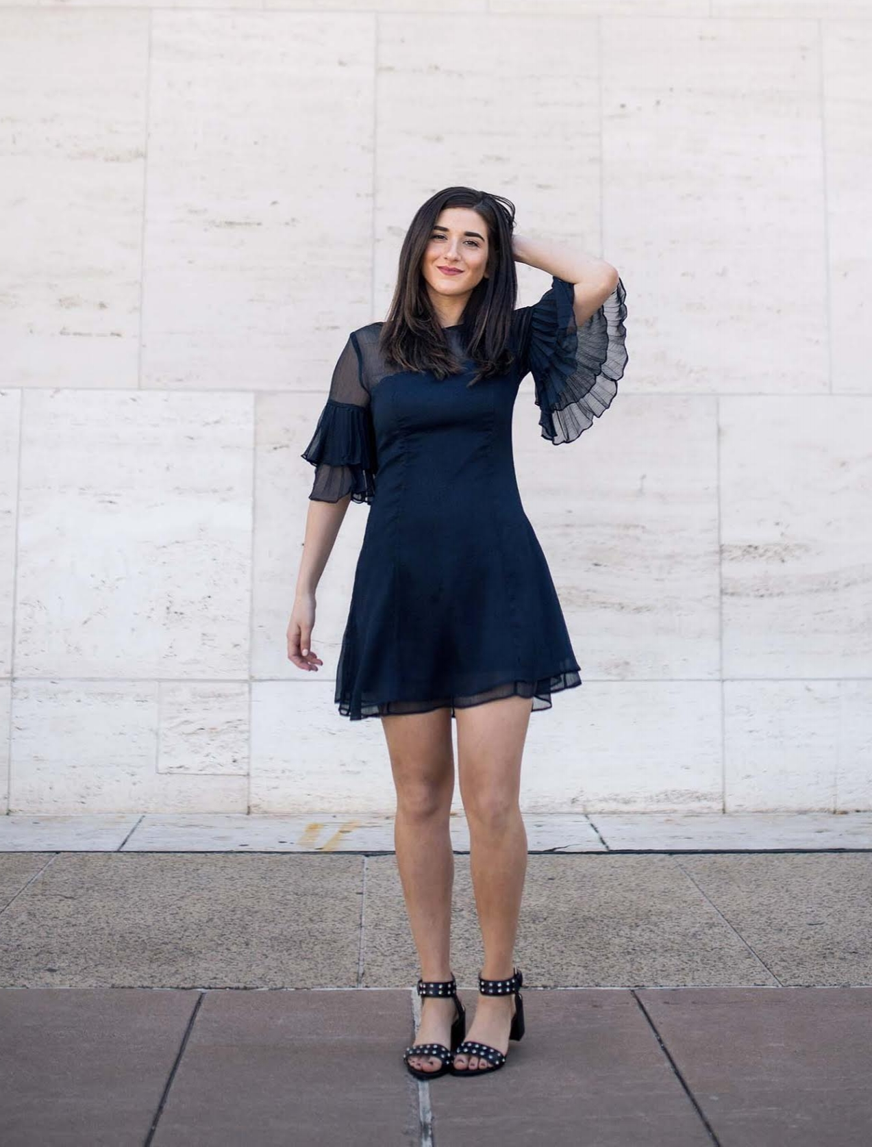 Lulus Ruffle Sleeve Dress The Best And Worst Fads of 2017 Esther Santer Fashion Blog NYC Street Style Blogger Outfit OOTD Trendy Pretty Feminine Navy Elegant Fancy Summer Look Sheer Black Studded Sandals Beauty Straight Hair Shop Photoshoot Girl Women.jpg