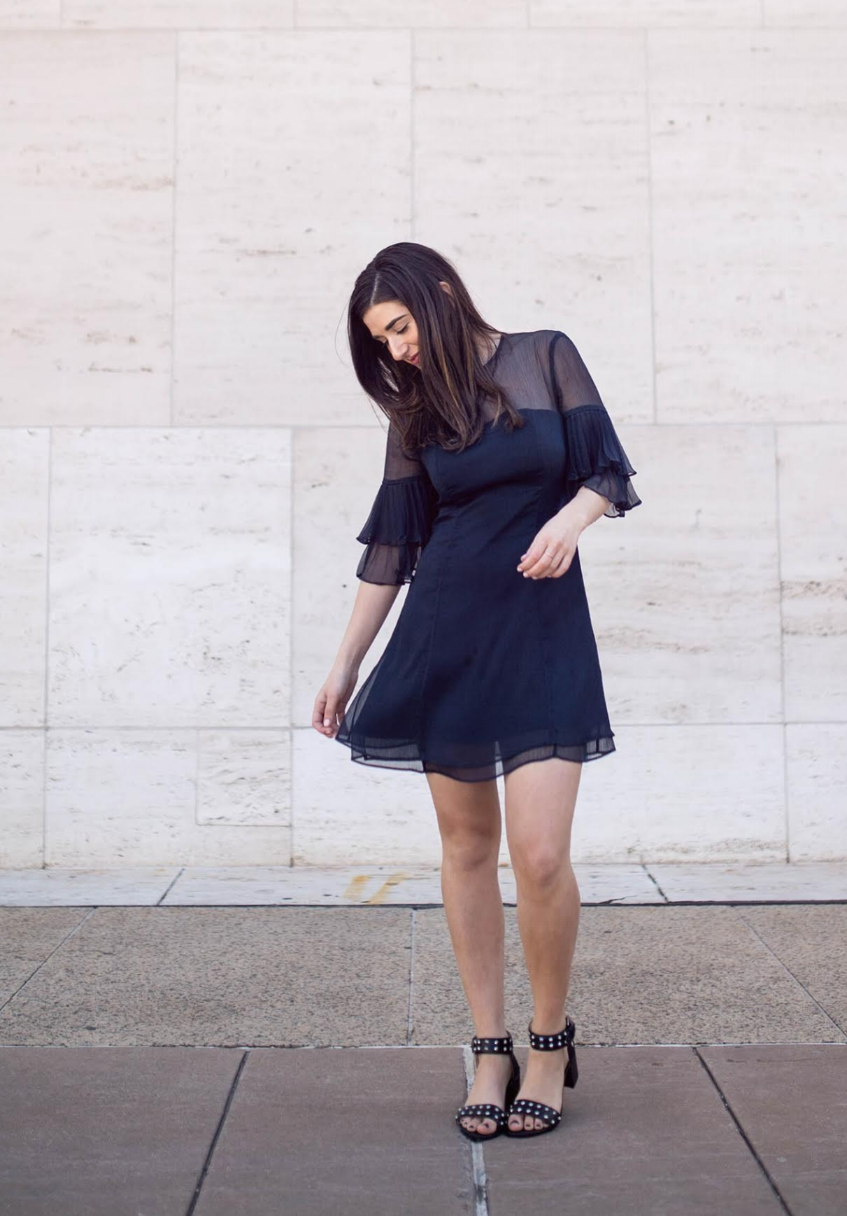 Lulus Ruffle Sleeve Dress The Best And Worst Fads of 2017 Esther Santer Fashion Blog NYC Street Style Blogger Outfit OOTD Trendy Pretty Feminine Navy Elegant Fancy Summer Look Sheer Black Studded Sandals Straight Hair Beauty Photoshoot Girl Women Shop.jpg