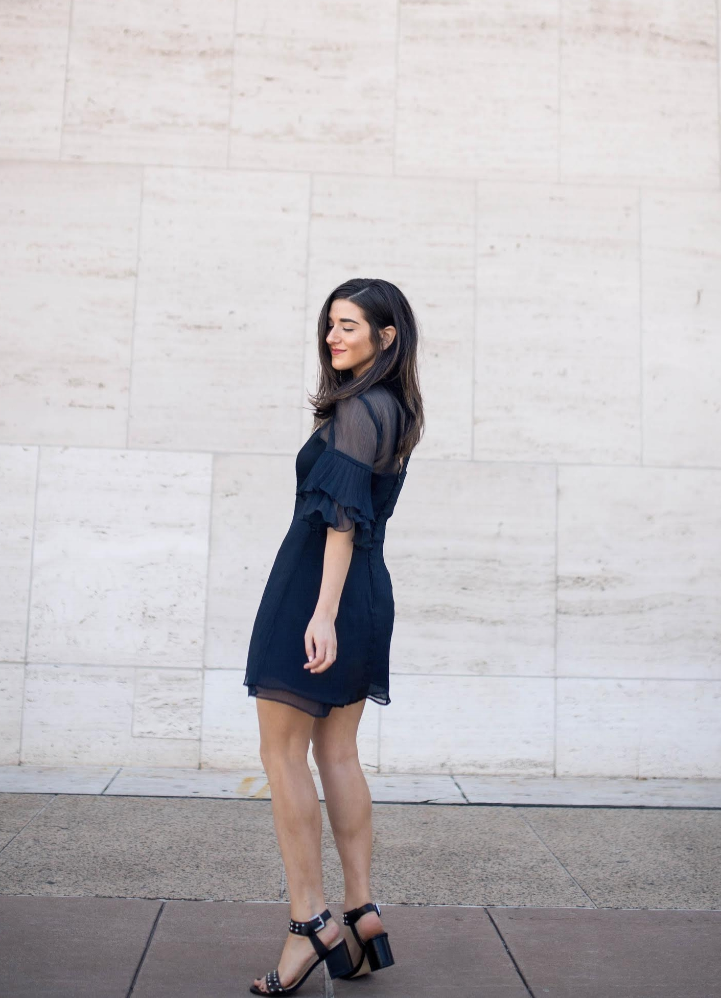 Lulus Ruffle Sleeve Dress The Best And Worst Fads of 2017 Esther Santer Fashion Blog NYC Street Style Blogger Outfit OOTD Trendy Pretty Feminine Navy Elegant Fancy Summer Look Sheer Black Studded Sandals Straight Hair Beauty Photoshoot Women Girl Shop.jpg