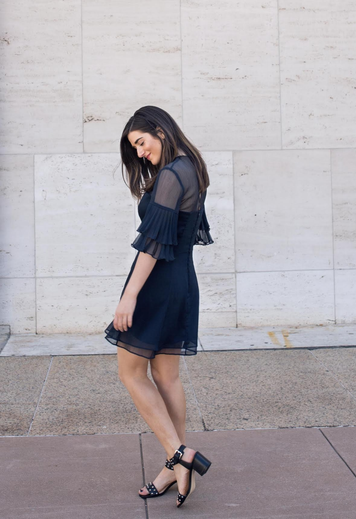 Lulus Ruffle Sleeve Dress The Best And Worst Fads of 2017 Esther Santer Fashion Blog NYC Street Style Blogger Outfit OOTD Trendy Pretty Feminine Navy Elegant Fancy Summer Look Sheer Black Studded Sandals Straight Photoshoot Hair Beauty Girl Women Shop.jpg