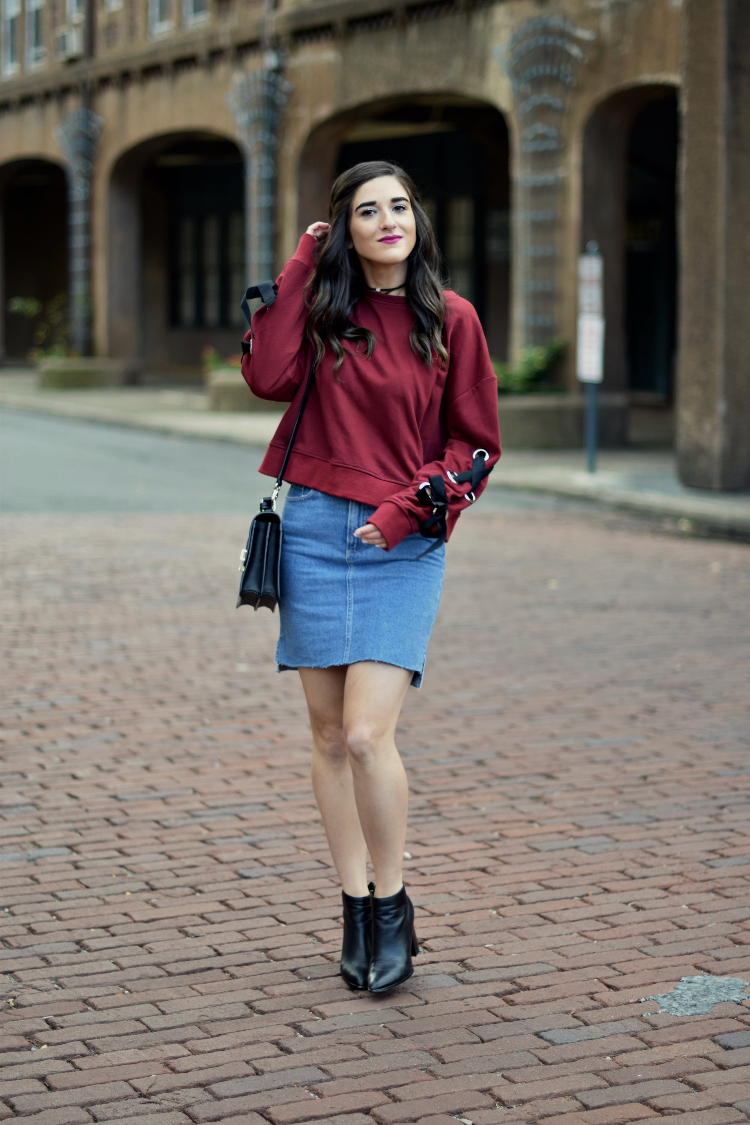 Red Lace-Up Sleeve Sweatshirt Denim Skirt 10 Things I'm Thankful For This Year Esther Santer Fashion Blog NYC Street Style Blogger Outfit OOTD Trendy Girl Women Choker Black Booties Hair Brunette Henri Bendel West 57th Schoolbag Winter Look Fall OOTD.jpg