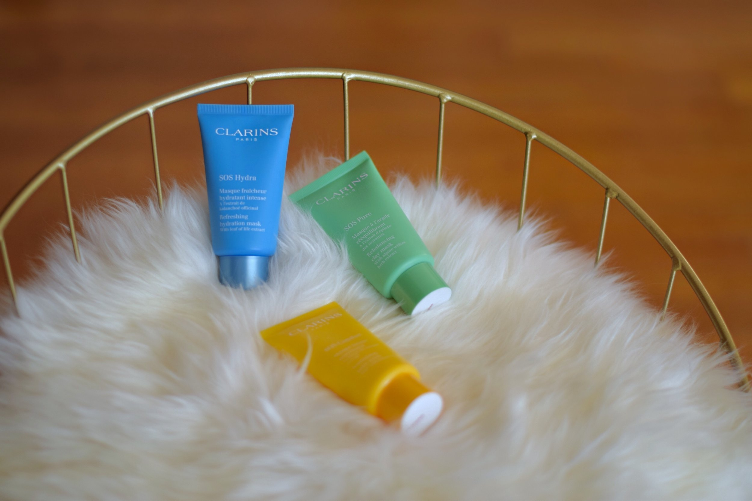 SOS Face Masks Clarins Esther Santer Fashion Blog NYC Street Style Blogger Outfit OOTD Trendy Beauty Product Review Colorful Blue Green Yellow Bottle Moisturize Masque Rebalancing Shop Skincare Skin Routine Comfort Girl Women New York City  Hydrate.jpg
