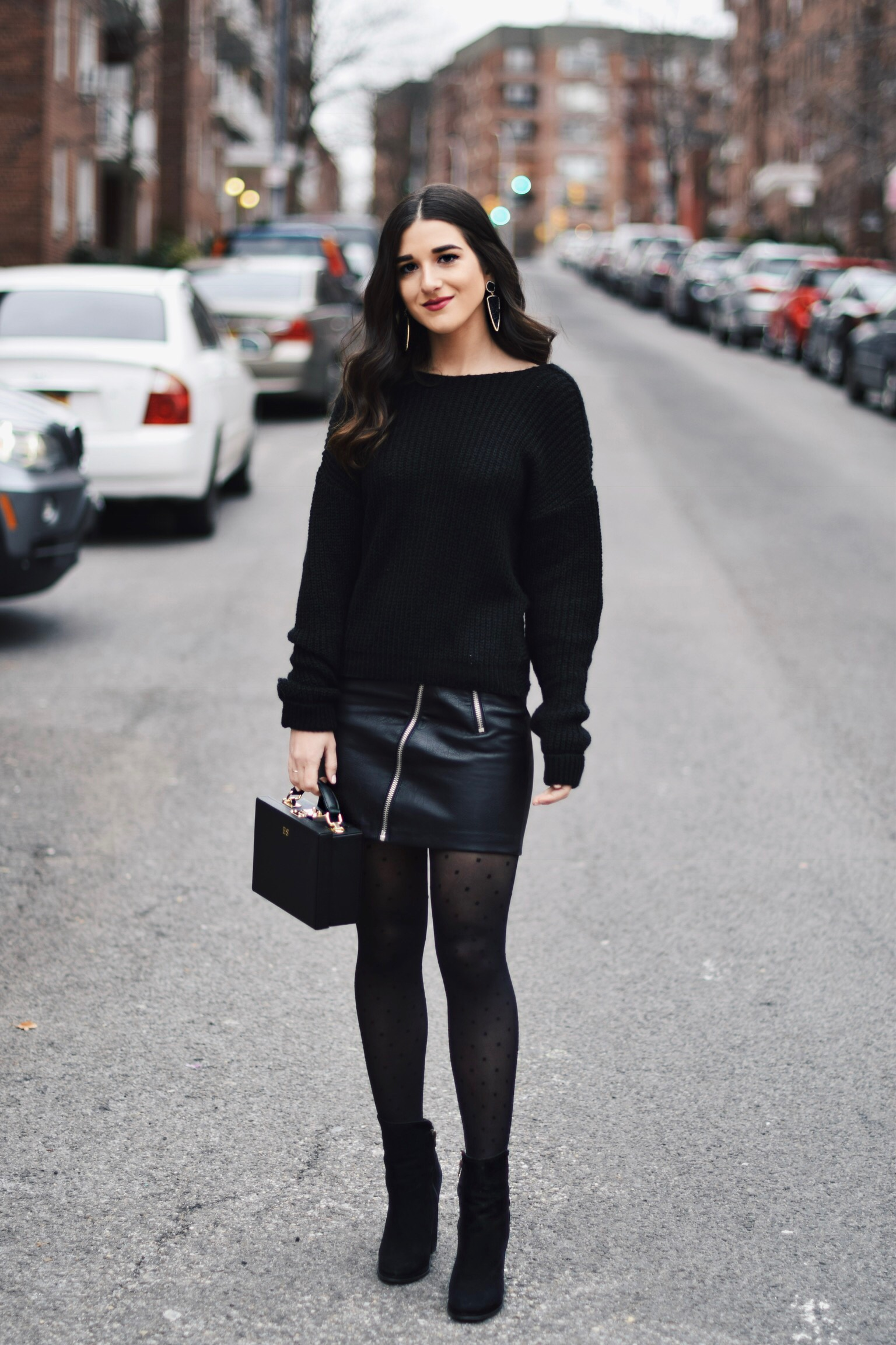 All Black Look 5 Ways To Keep Your New Year's Resolution Going Strong Esther Santer Fashion Blog NYC Street Style Blogger Outfit OOTD Trendy BaubleBar Earrings Monogrammed Box Bag Daily Edited Girl Women Booties Pleather Mini Skirt Polka Dot Tights.jpg