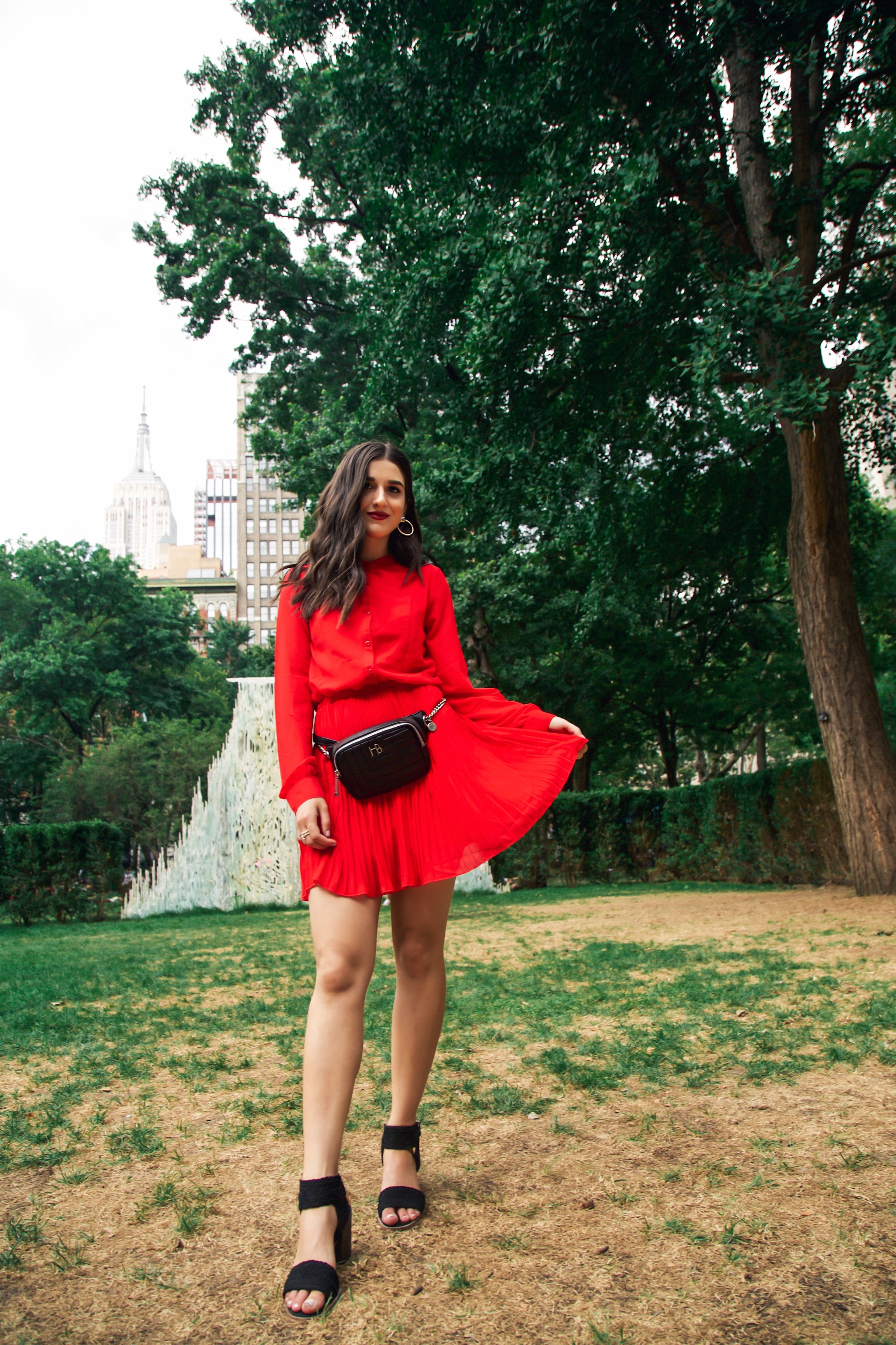 What Do Bloggers Do With All The Free Products They Receive Red Pleated Dress Black Belt Bag Esther Santer Fashion Blog NYC Street Style Blogger Outfit OOTD Trendy ASOS Vince Camuto Braided Sandals Shoes Hair Women Girl Fanny Pack Fall Summer Shopping.jpg