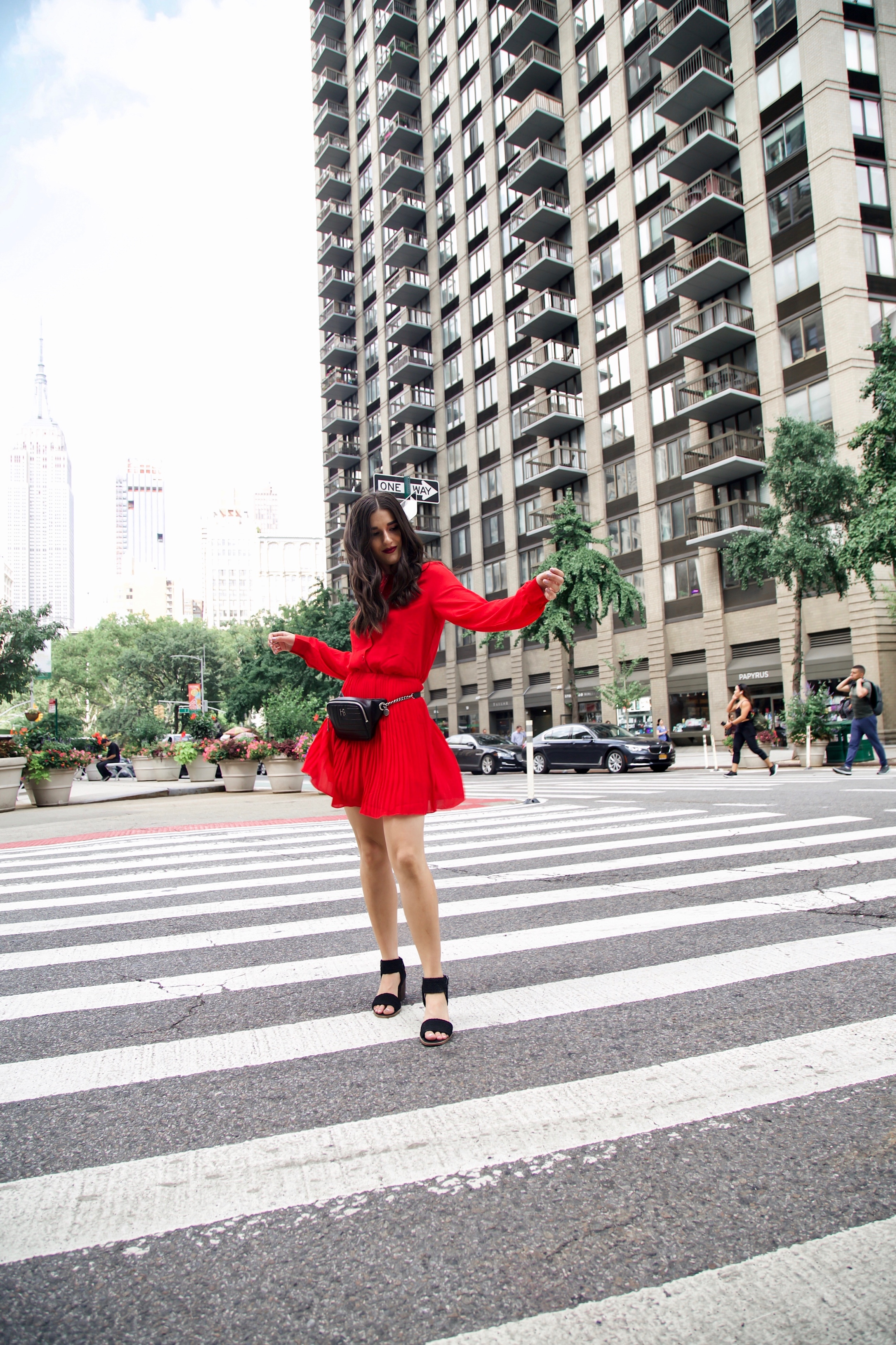 What Do Bloggers Do With All The Free Products They Receive Red Pleated Dress Black Belt Bag Esther Santer Fashion Blog NYC Street Style Blogger Outfit OOTD Trendy ASOS Vince Camuto Braided Sandals Shoes Hair Women Girl Summer Fanny Pack Fall Shopping.jpg