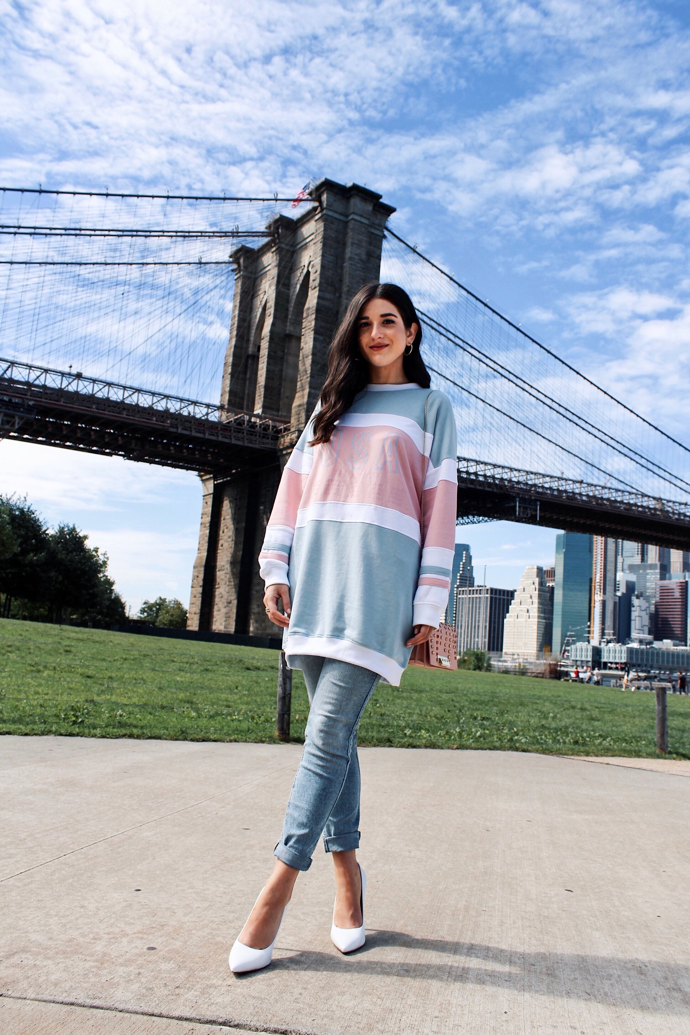 How To Style Kenneth Cole's White Riley Heels Esther Santer Fashion Blog NYC Street Style Blogger Outfit OOTD Trendy Brand Collaboration Comfortable Casual Wear Jeans Oversized Sweatshirt Pink Zac Posen Bag Girl Women  Dumbo Photoshoot Carousel Bridge.jpg
