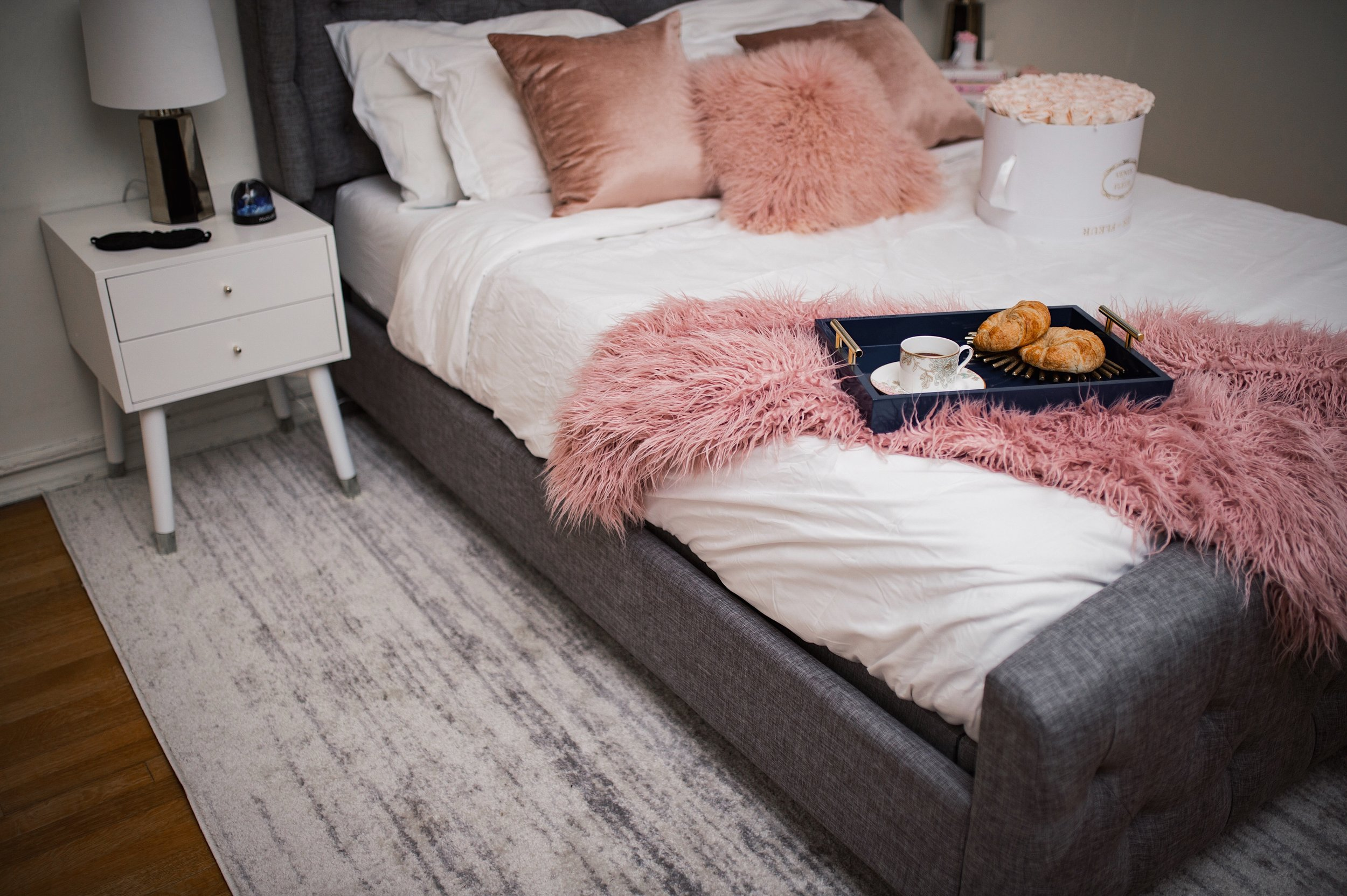 My Bedroom Reveal Joss & Main Esther Santer Fashion Blog NYC Street Style Blogger White Duvet Cover Pink Furry Throw Pillows Blanket Blush Gold Lamps Grey Bed Headboard Shopping Buy Beautiful Room  Furniture White Nightstands Navy Tray Art Breakfast.jpg