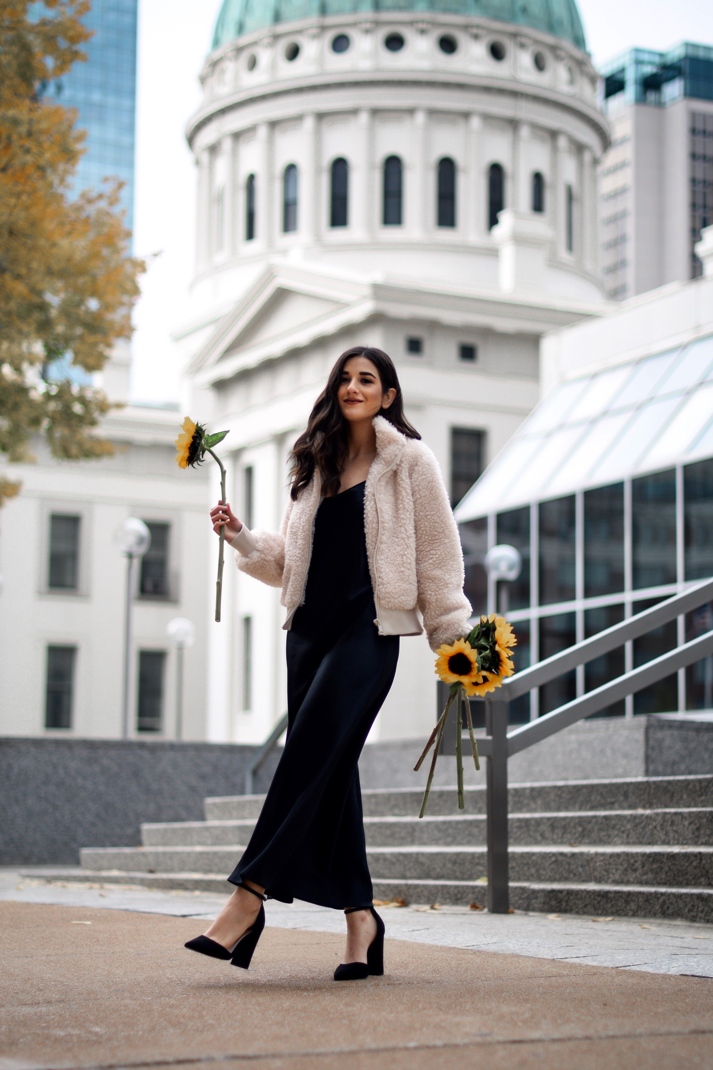 The 10 Most Frustrating Parts Of Brand Collabs Long Black Slip Dress Shearling Jacket Esther Santer Fashion Blog NYC Street Style Blogger Outfit OOTD Trendy Shopping St. Louis Photoshoot Hometown  Downtown Saint Louis Sunflowers Yellow Flowers Heels.jpg
