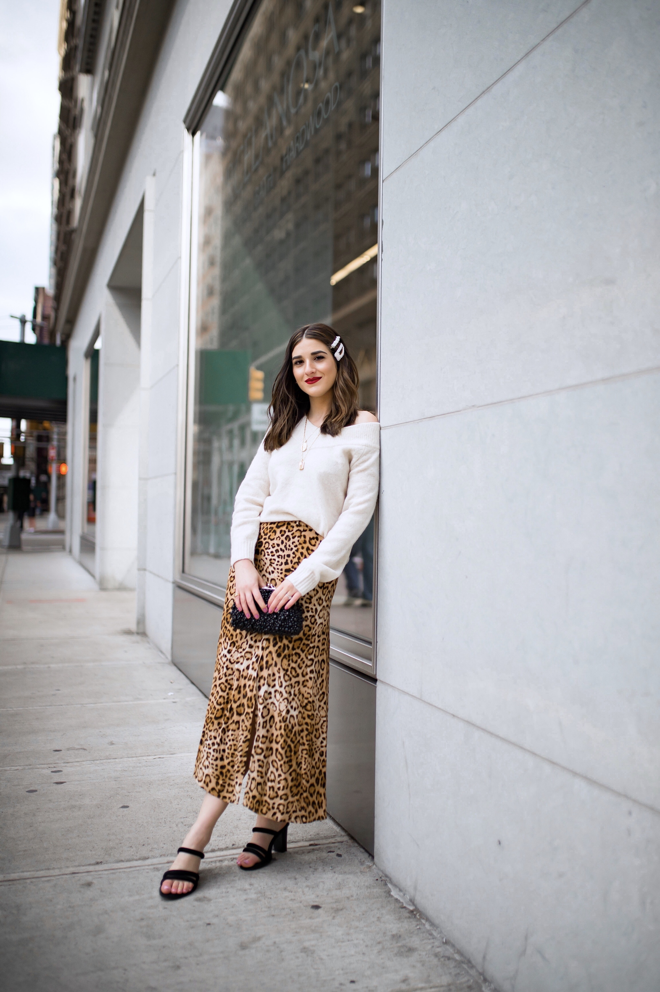 The Instagram Likes Debate Leopard Midi Skirt Beige Sweater Esther Santer Fashion Blog NYC Street Style Blogger Outfit OOTD Trendy Shopping Girl What Wear H&M Zara Pearl Barrettes Hair Clips Accessories Mules Sandals Bag Beaded Clutch Spring Necklaces.jpg