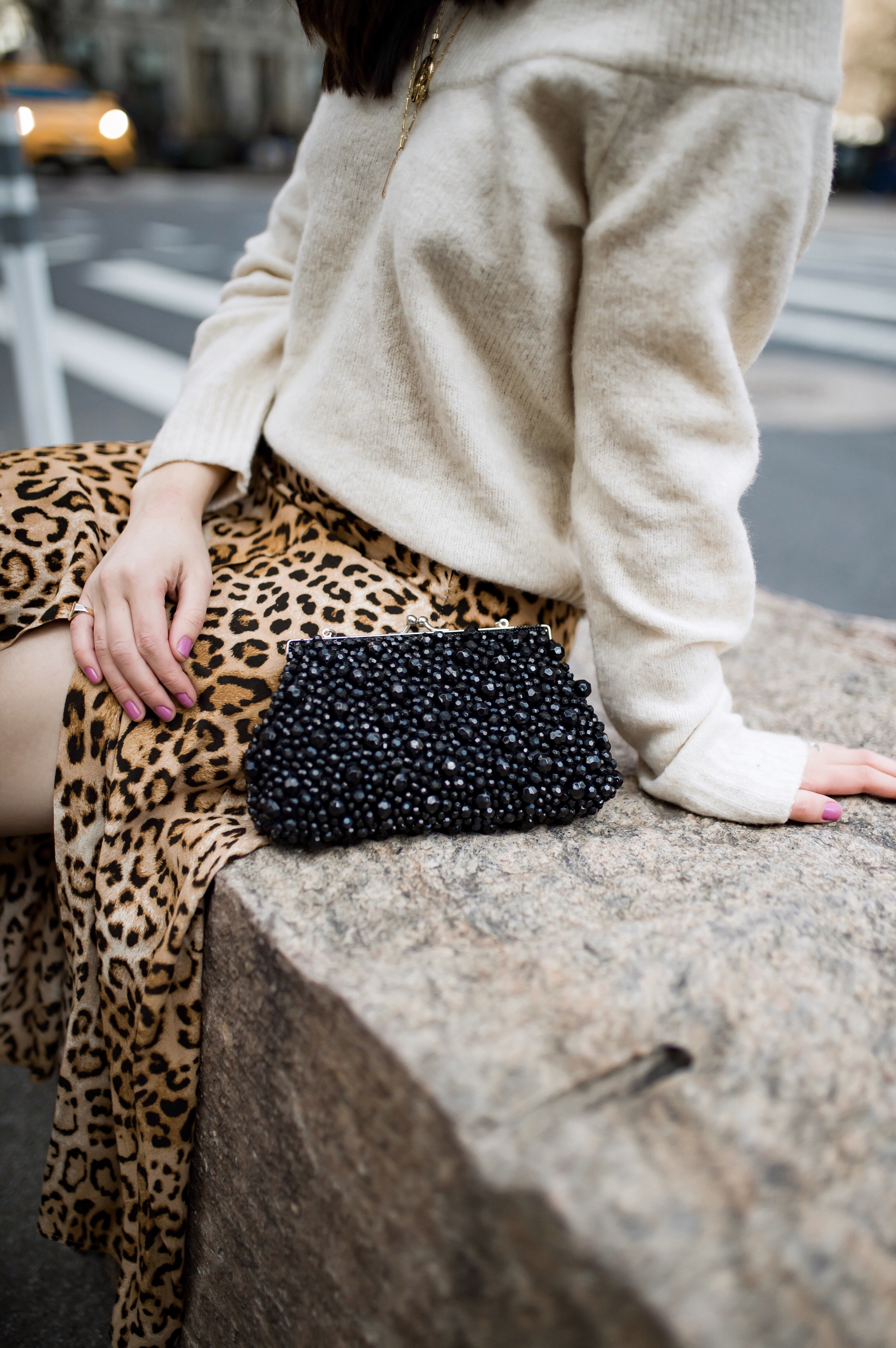 The Instagram Likes Debate Leopard Midi Skirt Beige Sweater Esther Santer Fashion Blog NYC Street Style Blogger Outfit OOTD Trendy Shopping Girl What Wear H&M Zara Pearl Barrettes Hair Clips Accessories Sandals Mules Bag Beaded Clutch Spring Necklaces.jpg