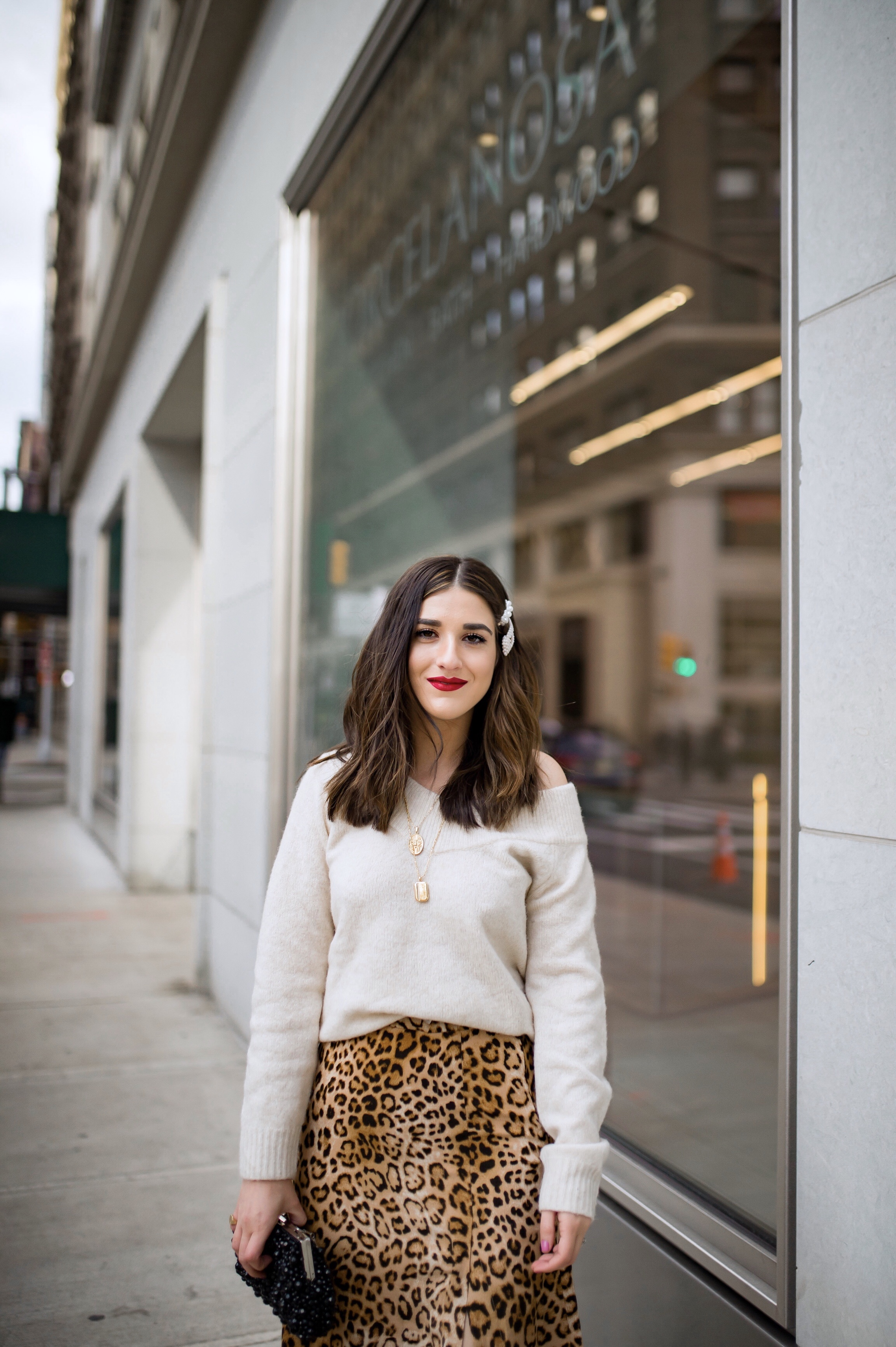 The Instagram Likes Debate Leopard Midi Skirt Beige Sweater Esther Santer Fashion Blog NYC Street Style Blogger Outfit OOTD Trendy Shopping Girl What Wear H&M Zara Pearl Barrettes Hair Clips Accessories Sandals Mules Necklaces Bag Beaded Clutch Spring.jpg