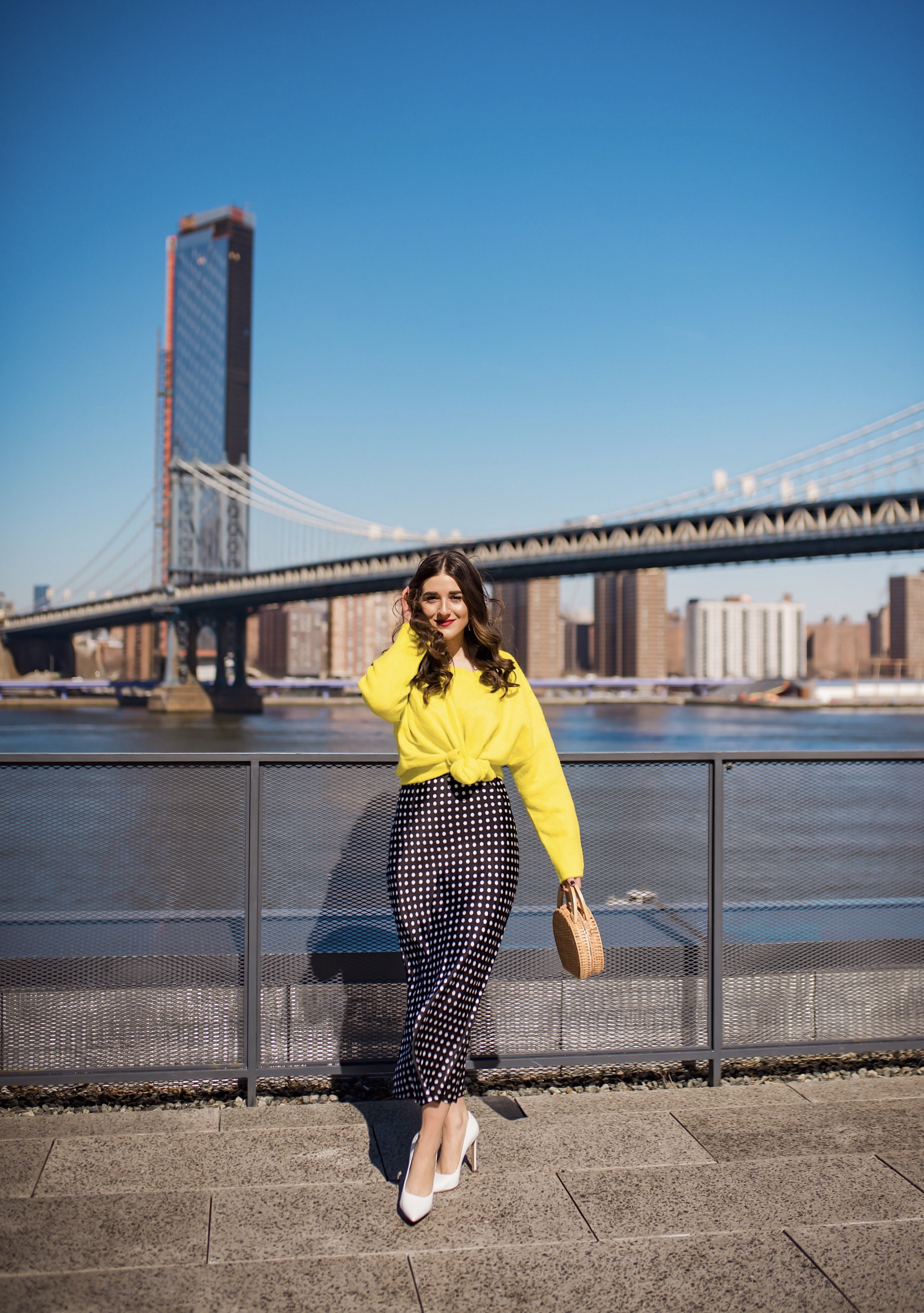 How I Wound Up With Boring White Dishes Navy Polka Dot Dress Neon Yellow Knotted Sweater Esther Santer Fashion Blog NYC Street Style Blogger Outfit OOTD Trendy Shopping Girl What How To Wear White Heels Laurel Creative Photoshoot Dumbo Brooklyn Bridge.JPG