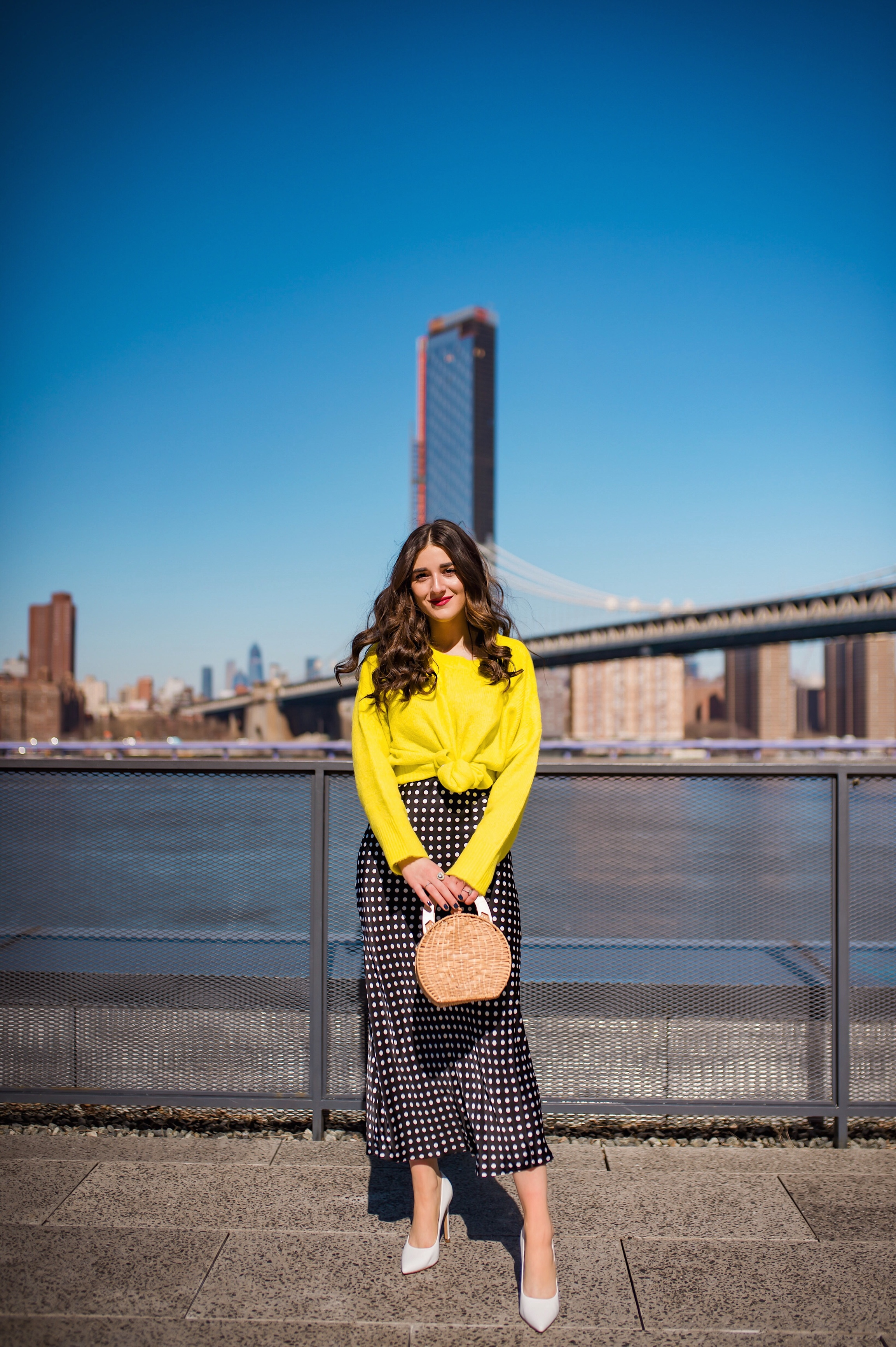 How I Wound Up With Boring White Dishes Navy Polka Dot Dress Neon Yellow Knotted Sweater Esther Santer Fashion Blog NYC Street Style Blogger Outfit OOTD Trendy Shopping Girl White Heels What How To Wear Brooklyn Bridge Laurel Creative Photoshoot Dumbo.JPG