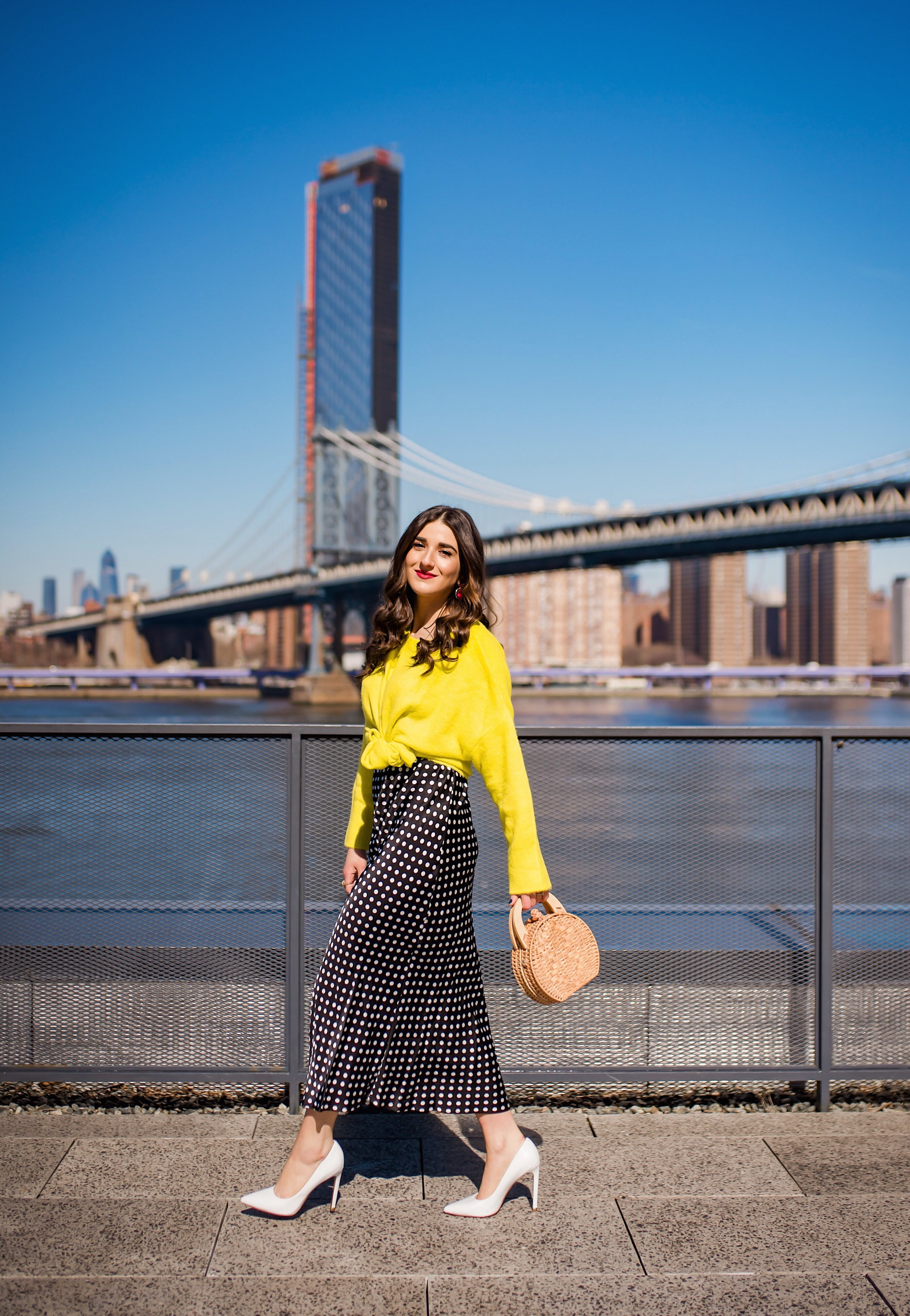 How I Wound Up With Boring White Dishes Navy Polka Dot Dress Neon Yellow Knotted Sweater Esther Santer Fashion Blog NYC Street Style Blogger Outfit OOTD Trendy Shopping Girl White Heels What How To Wear Photoshoot Dumbo Brooklyn Bridge Laurel Creative.JPG