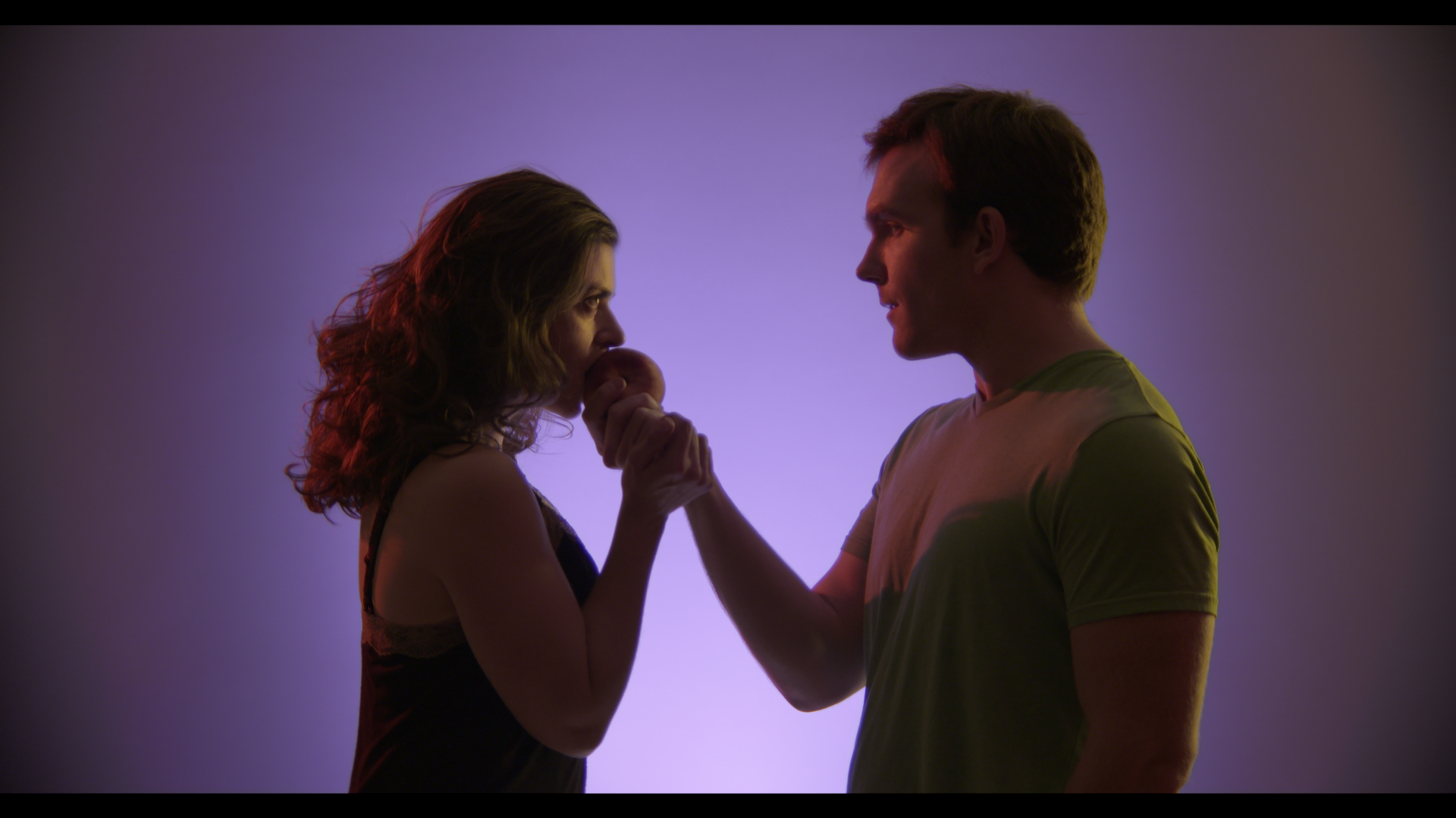 Claire (Amelia Mathews) and Franklin (Roger Wayne) share a peach during a psychic vision. Access a png version ofthe image at this  link and a jpeg  here.