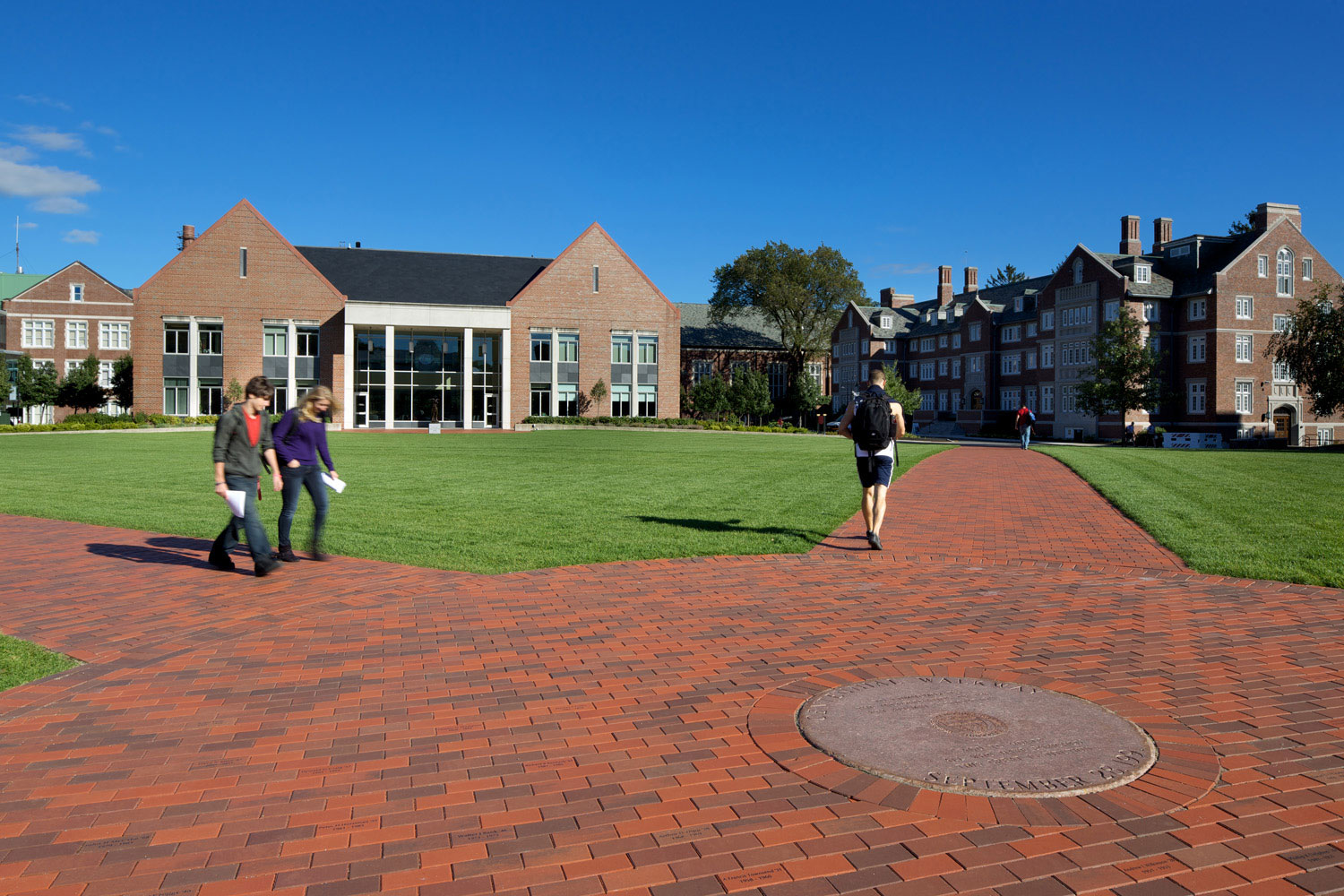WPI's colors of crimson and gray are reflected in the brick walkways. (Photo by Ed Wonsek)