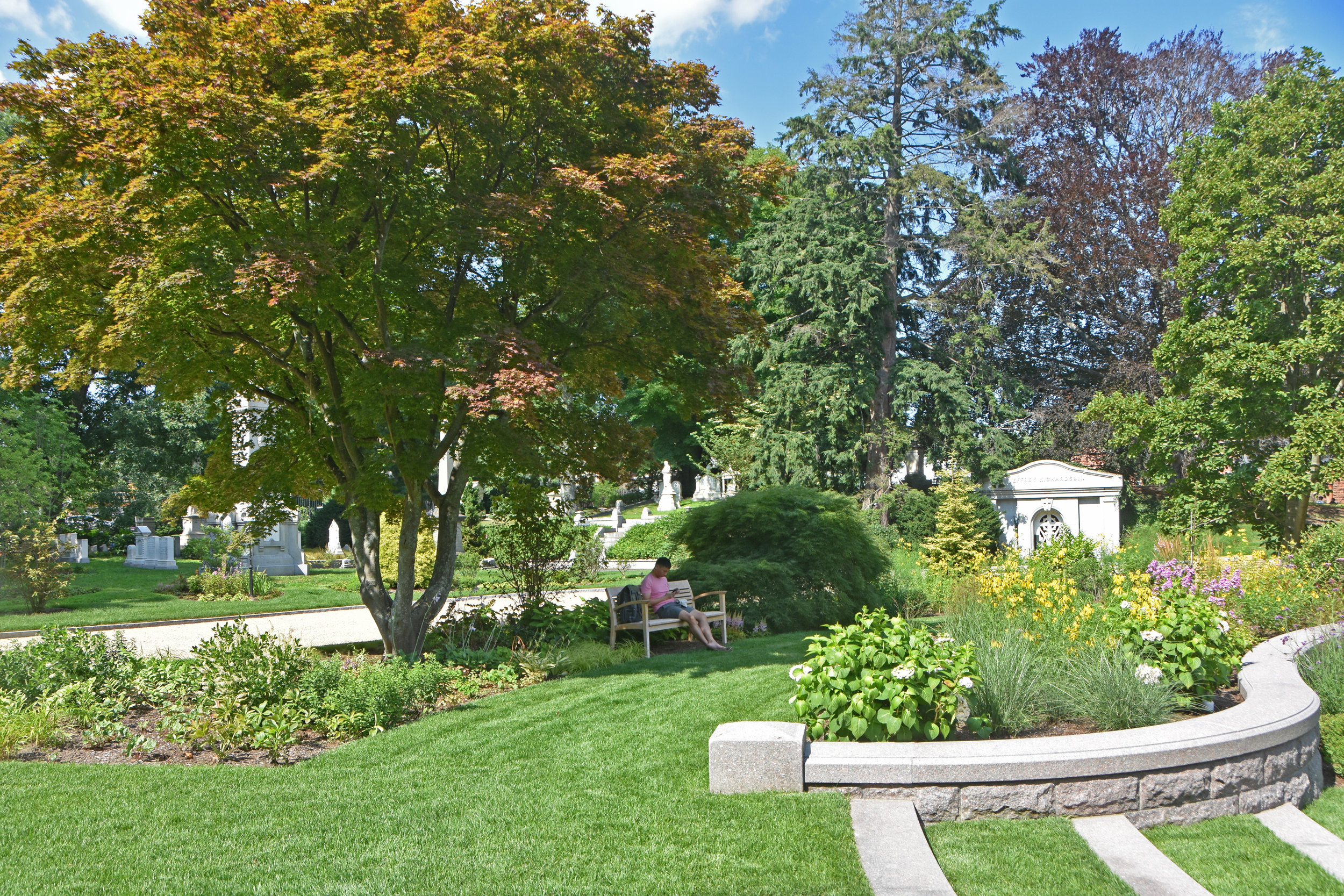 Shaded benches provide areas for people to sit and reflect. (photo by Jo Oltman)