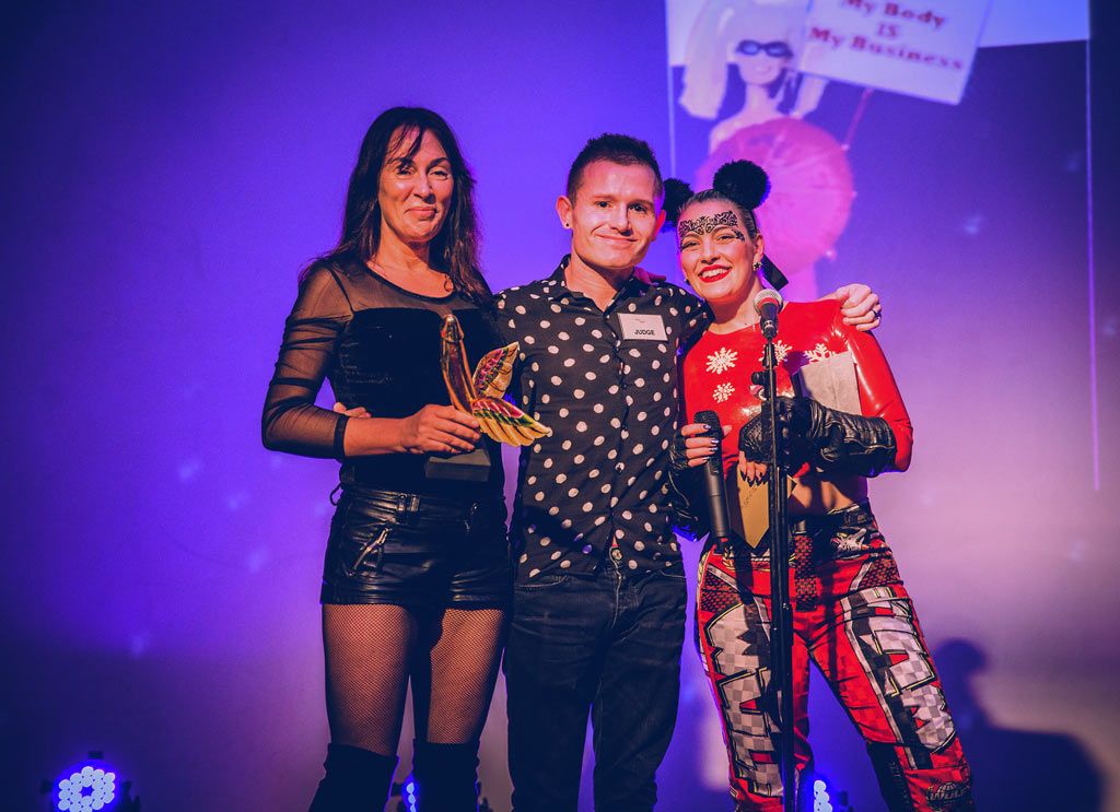 Sexual_Freedom_Awards_2016-SCOT-PEP_(Activist_Winner)-Alex_Feis-Bryce_(judge)-Alix_Fox_(compere)-Trophy_presentation-Copyright+Credit_Gina_Jackson-(025aw).jpg