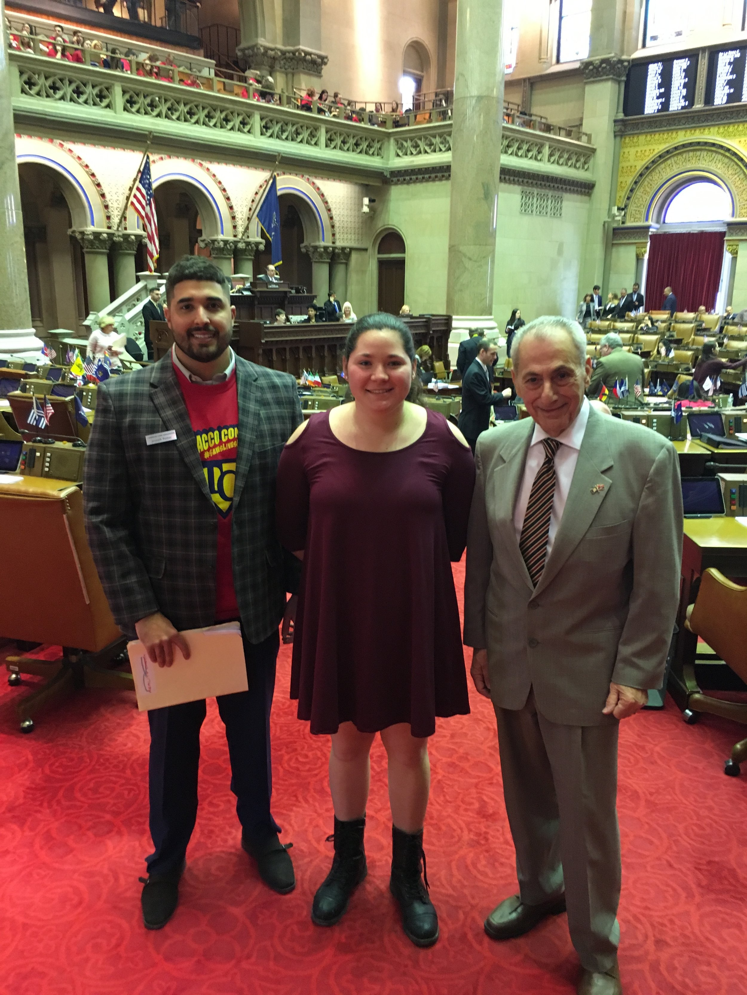 On The Floor - RC Program Coordinator Joseph Potter and RC State YAYA winner Lauren Cybul meet with Assemblyman Joe Errigo on the NY State chamber floor.