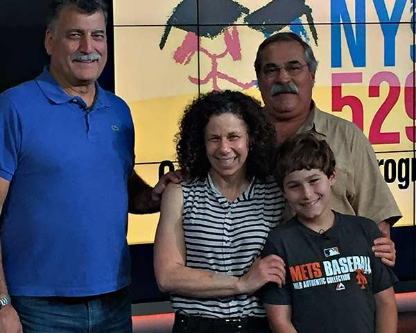 It was Keith Hernandez, the Mets announcer, left, who told Dante Sasso, above with his parents, Charlotte and Bruce, that he'd won.