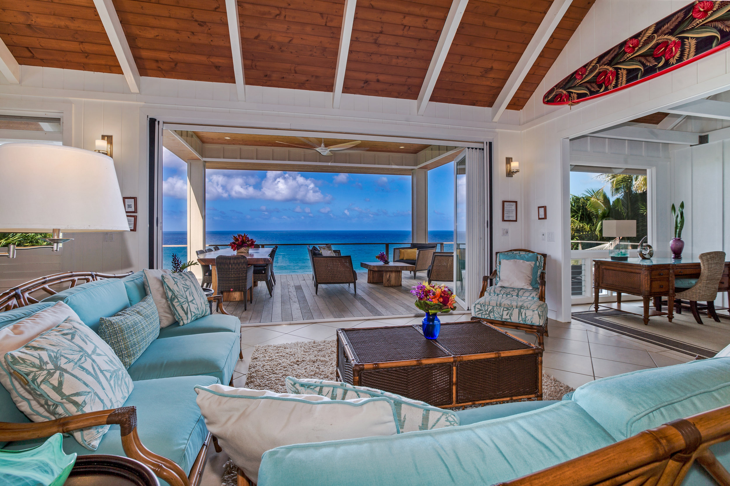 Luxurious great room opens fully to roofed oceanside living and dining area