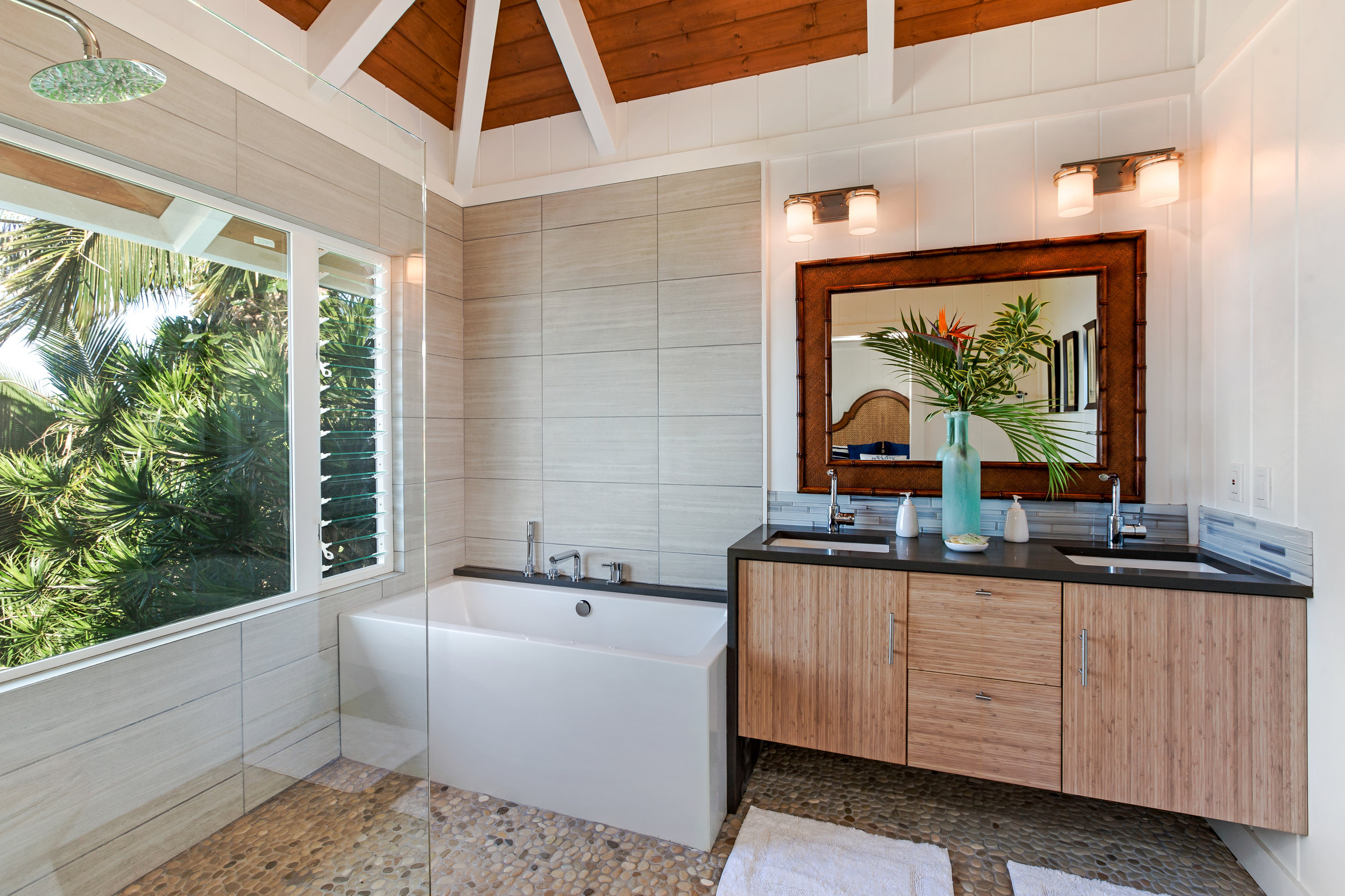 All bathrooms are newly renovated with high end features and fittings.  East oceanfront master ensuite features ocean view rain shower and soaker tub, and double hanging solid bamboo vanity with waterfall edge.