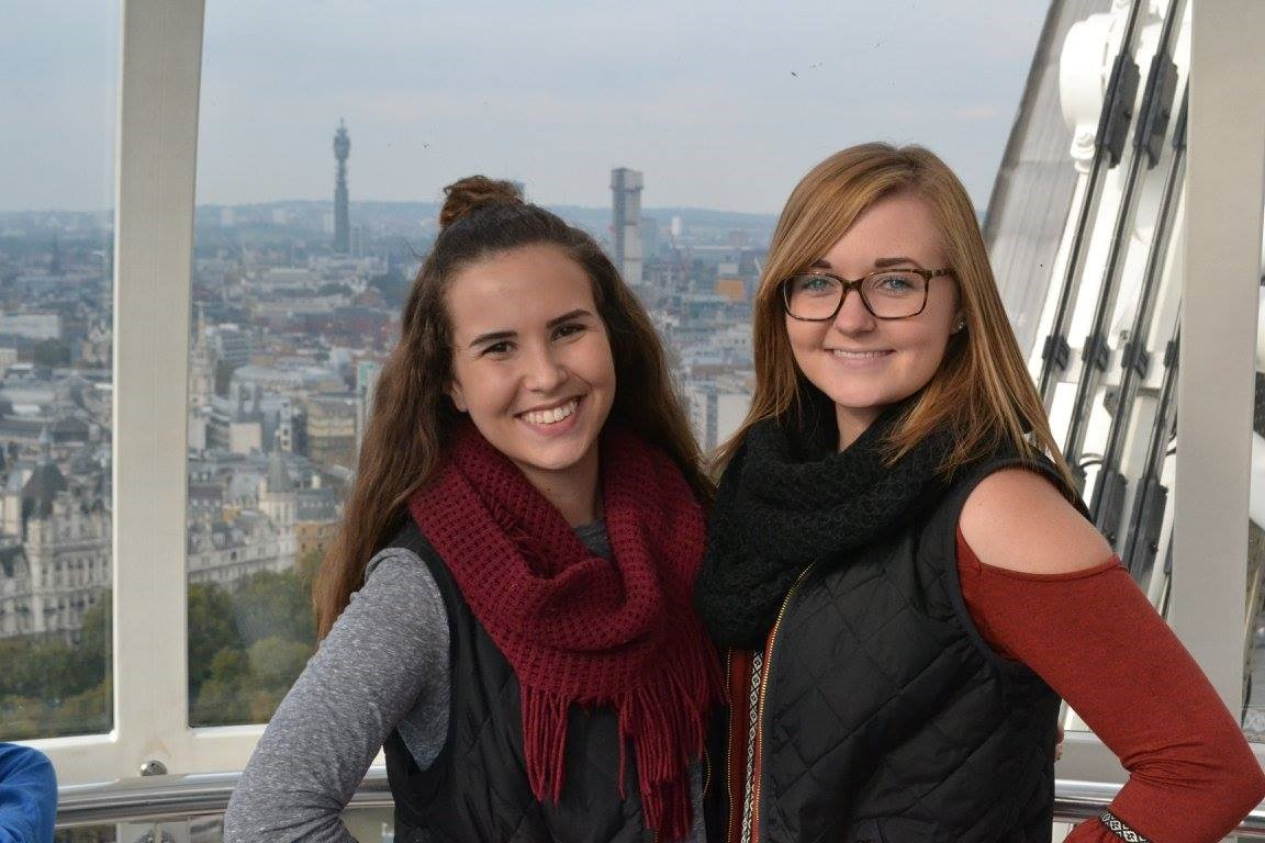 Brothers Megan Garner (left) and Erin Mickles (right) smile at the top of the London Eye.
