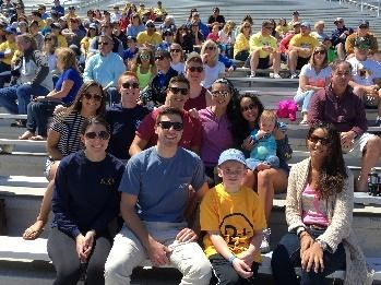 Brothers attend a Blue Hen's football game with Nate and family.