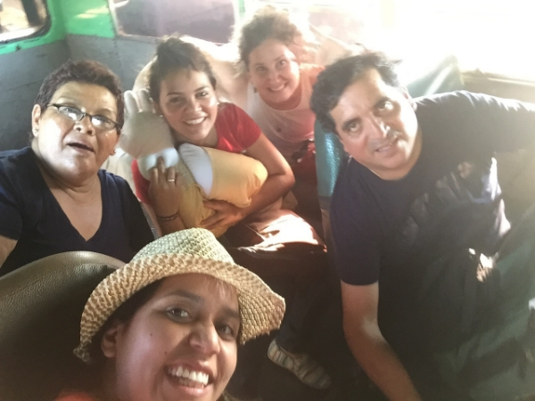 (From the bottom left, Angie, Maria Mercedes, Karen and Anibal enjoying the school bus!)