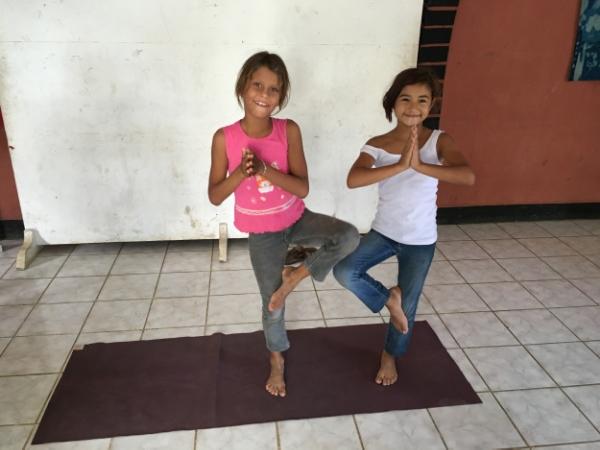 Paula and Aymi sharing my mat for tree pose.