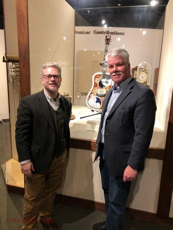 Brad Jacobs and Roland Murphy in front of the Prototype of the CF Martin 2 millionth guitar that RGM collaborated on with martin.