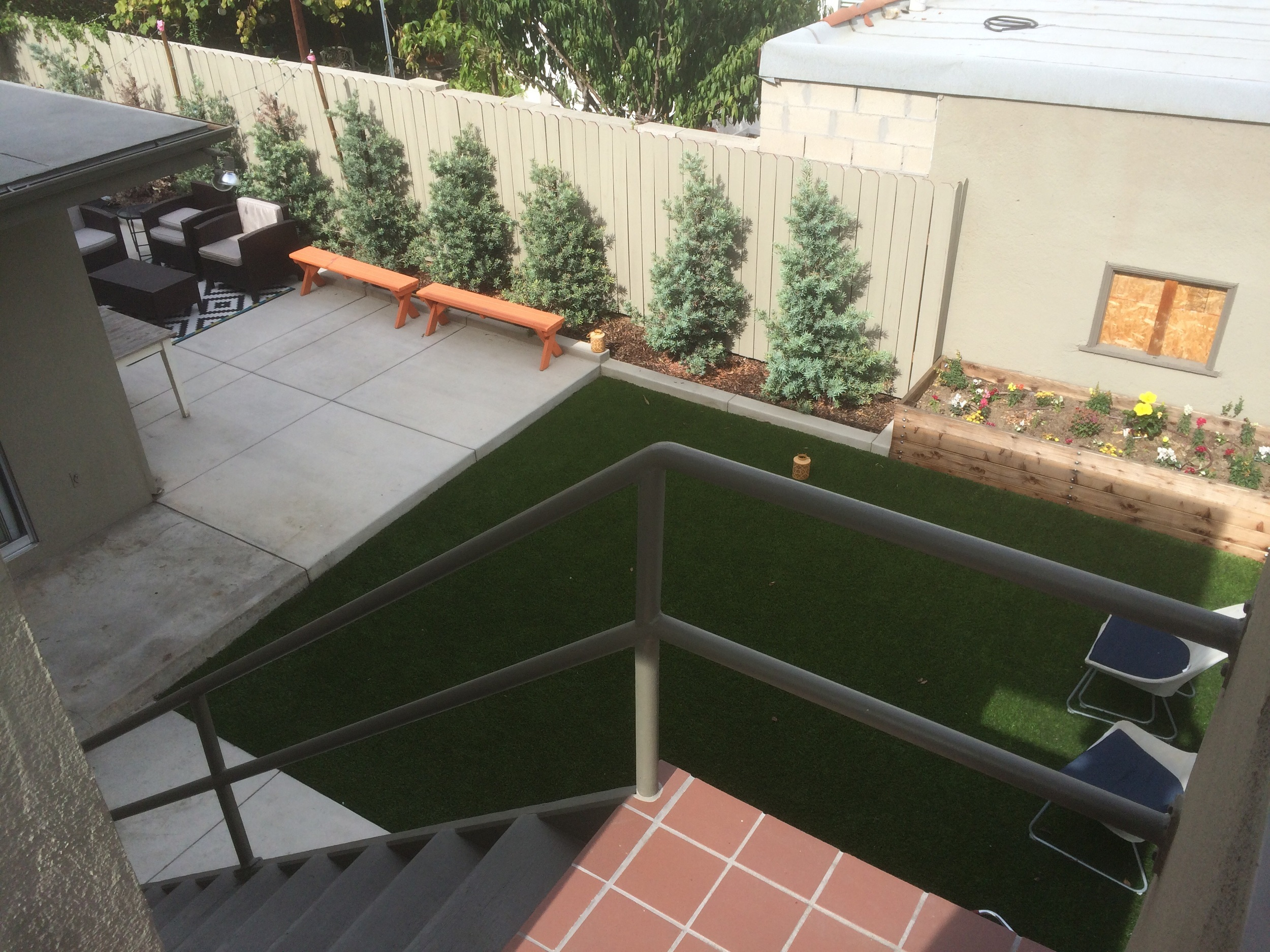 View of shared rear yard from upstairs landing.