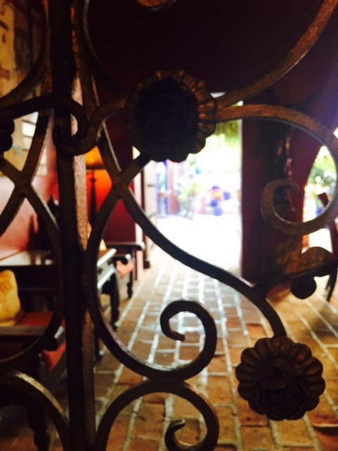 Gate  leading into patio dining area at Hotel California