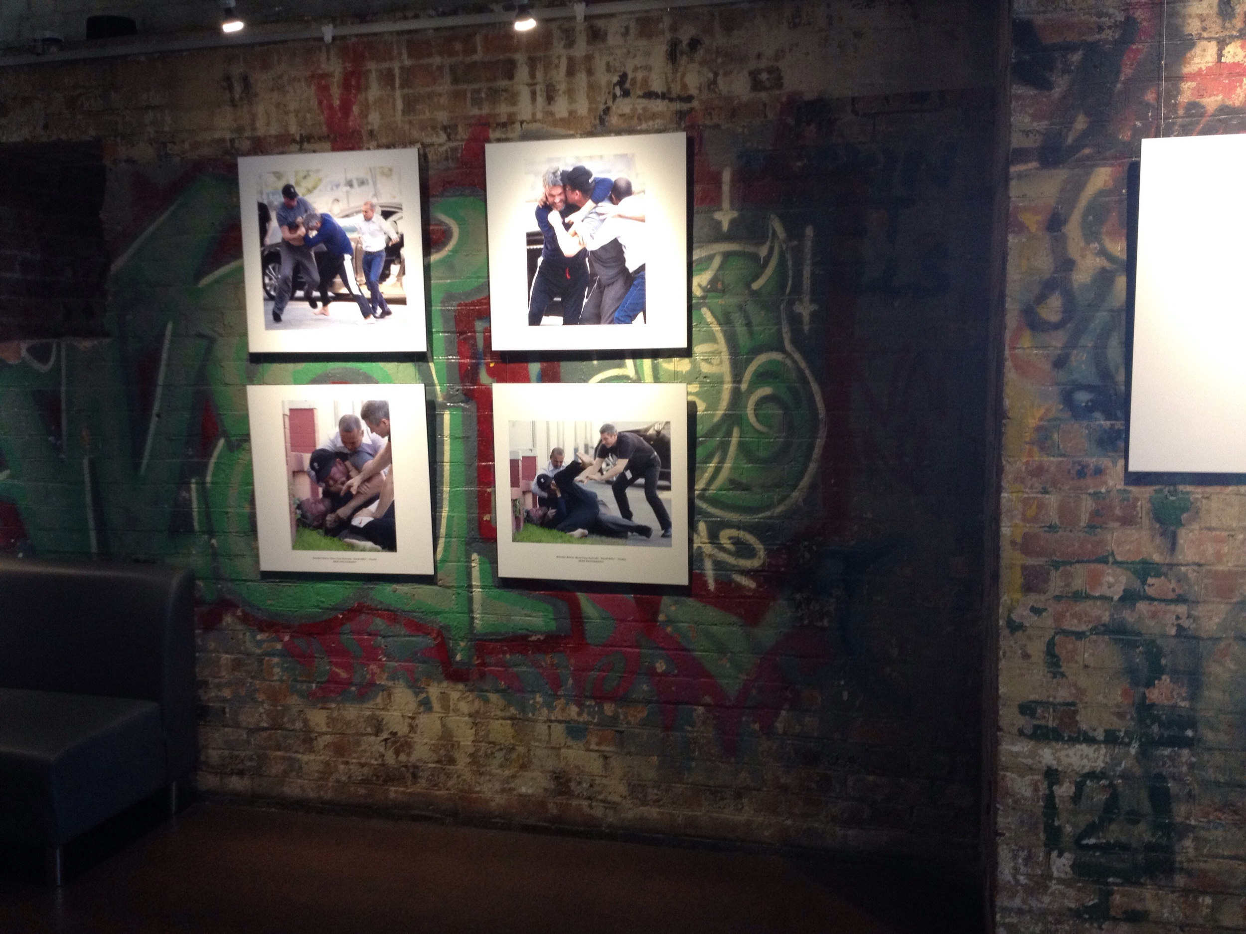 Graffiti covered walls and a photography exhibit