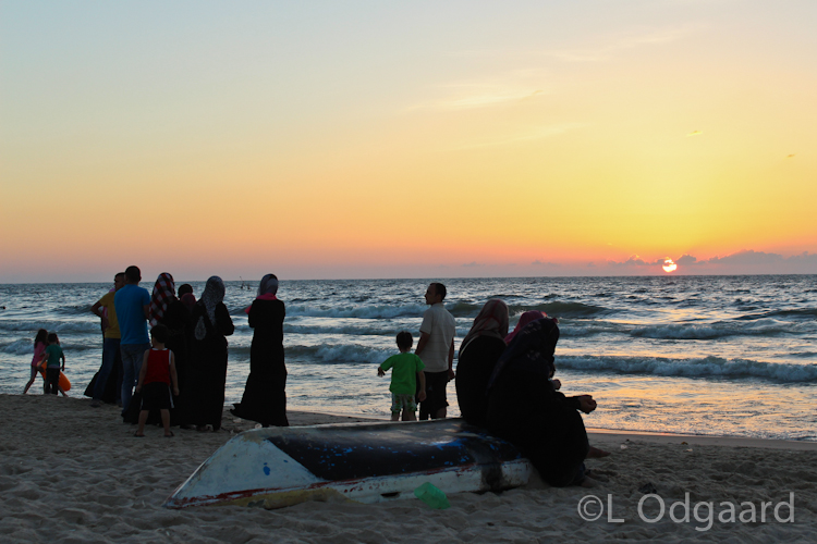Palestinian looking at sunset on Gaza beach