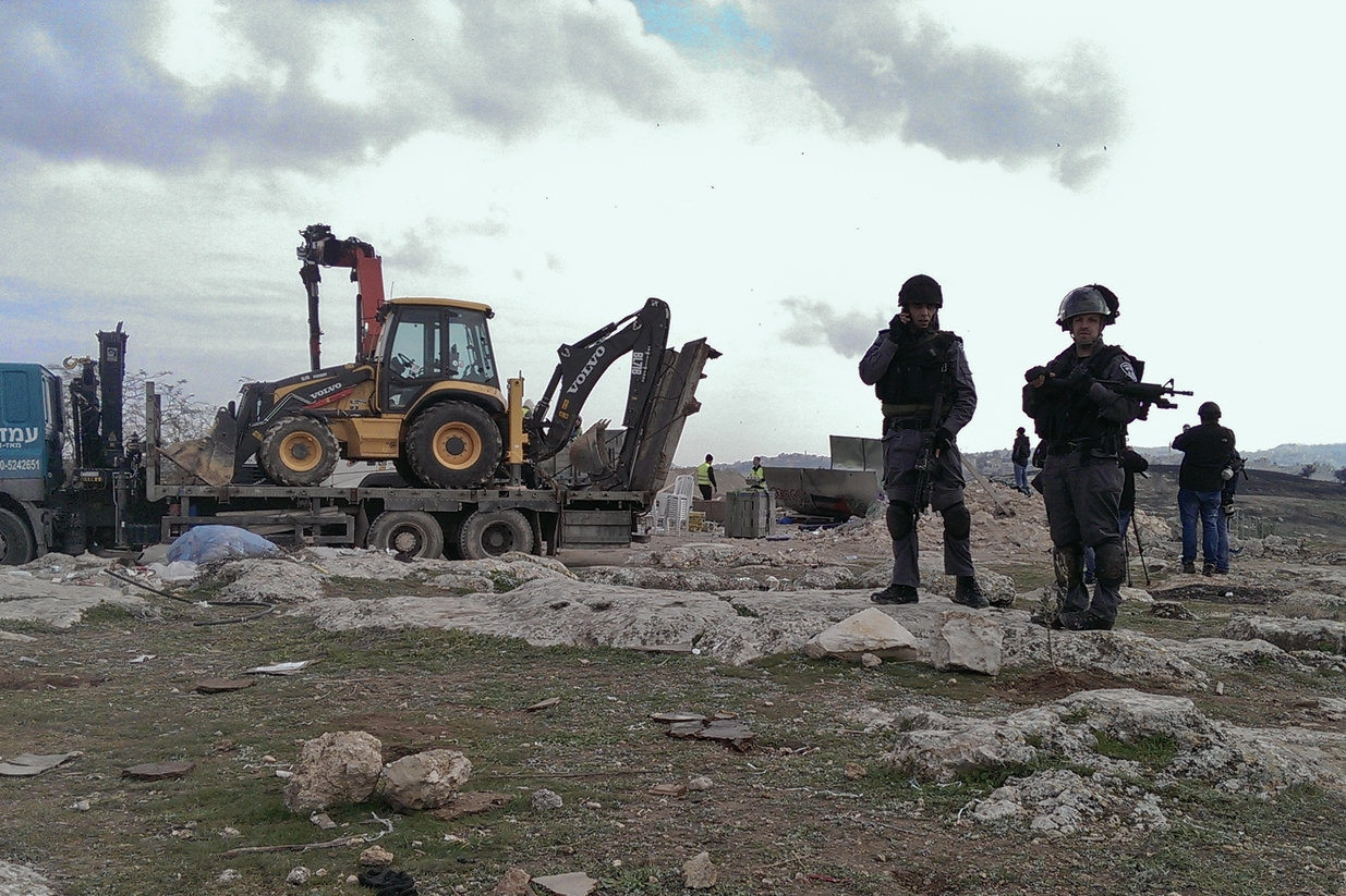 Israeli soldiers guard demolition of the camp