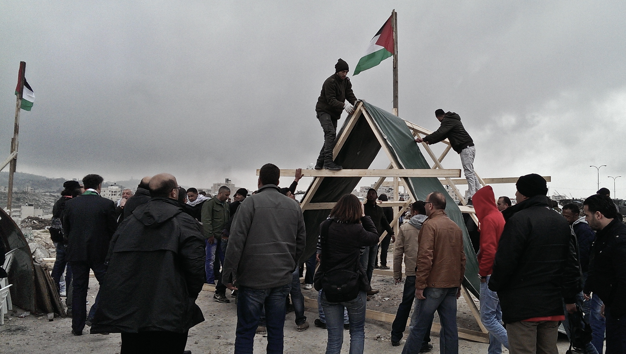 Residents of Abu Dis erect a tent in 'Bawabet al-Quds' to signal that they want to decide who lives and builds in the village's land. Feb 16, 2015 ©Lena Odgaard