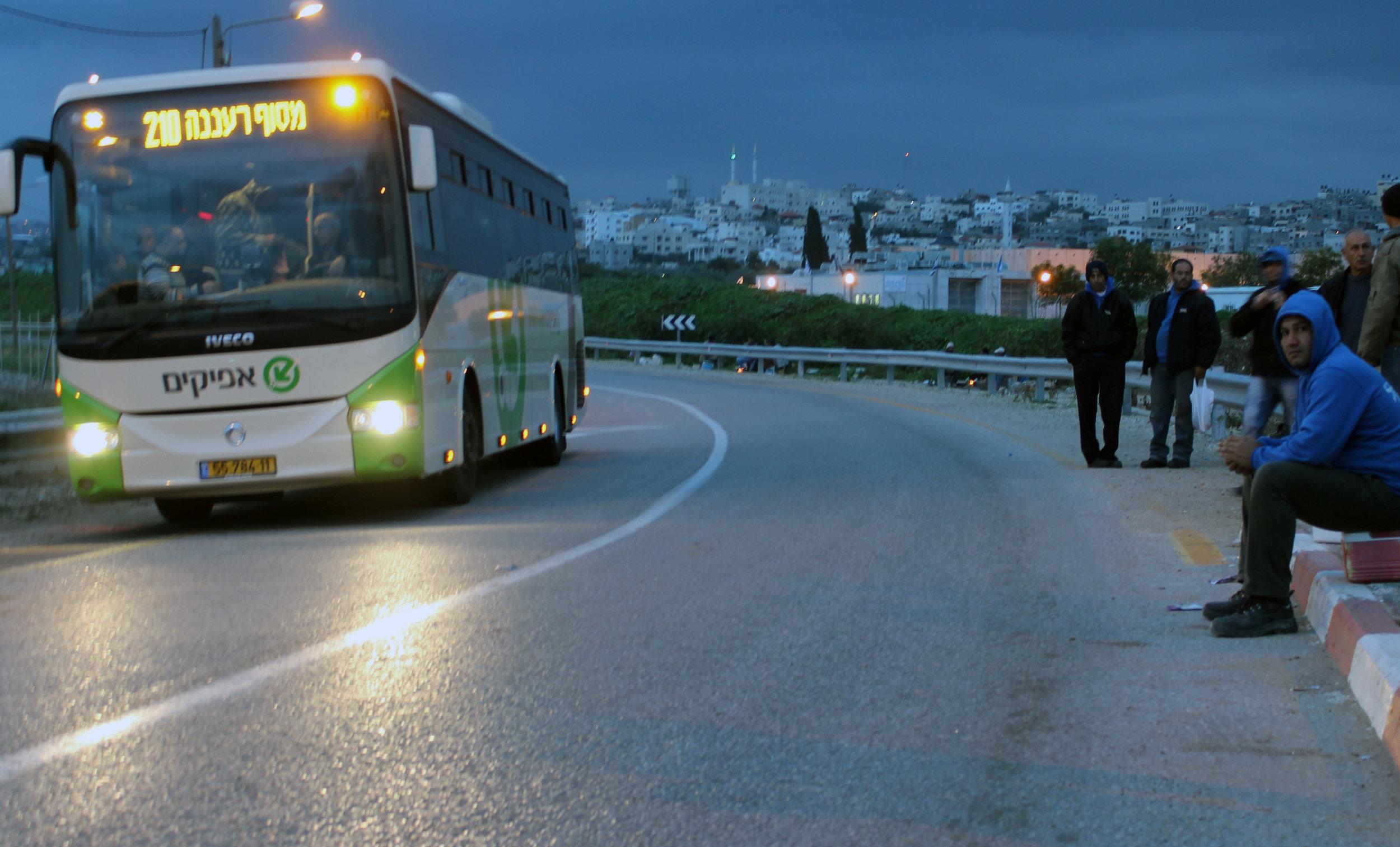 20130305 - Palestinian worker wait for bus2.jpg