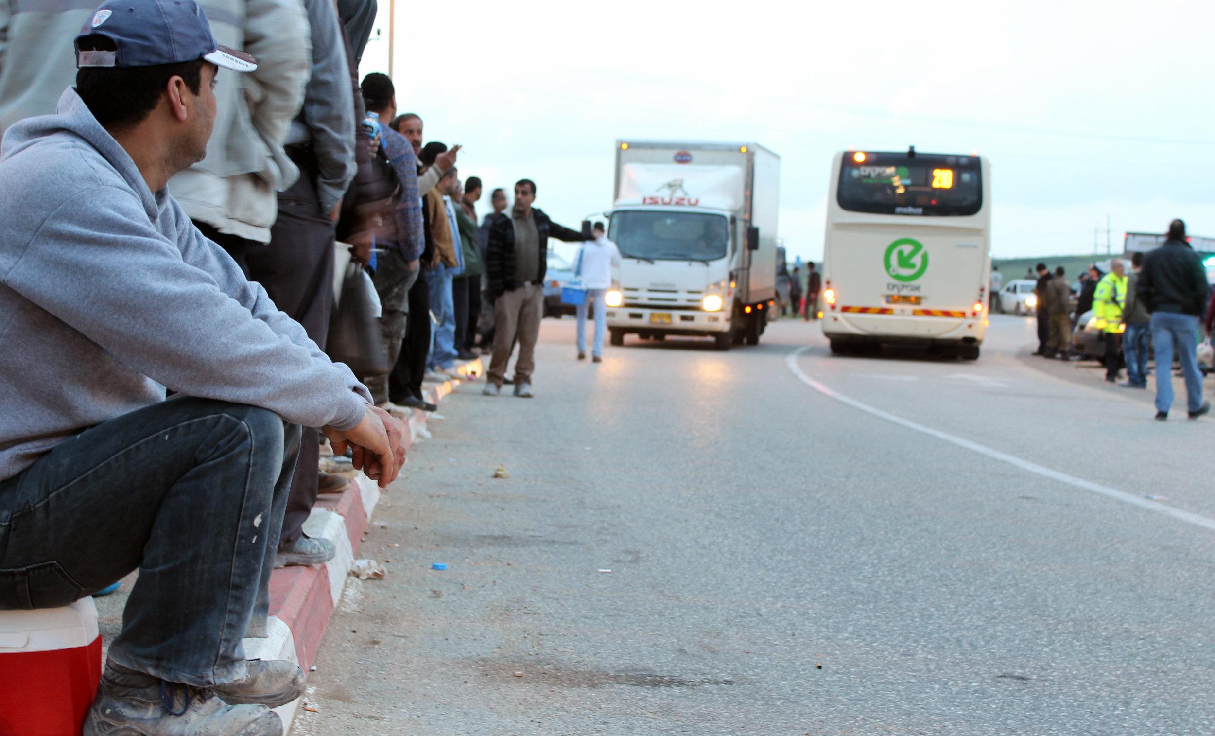 20130305 - Palestinian worker wait for bus.jpg