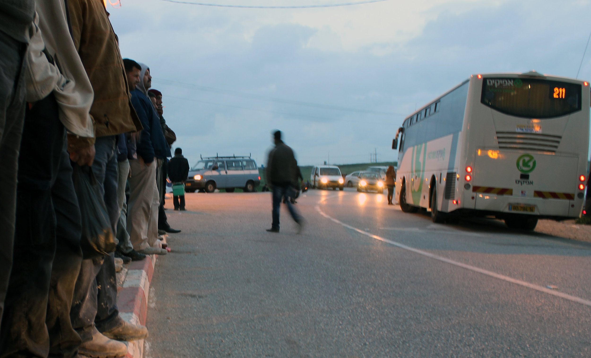 20130305 - Palestinian workers at curb waiting for bus.jpg