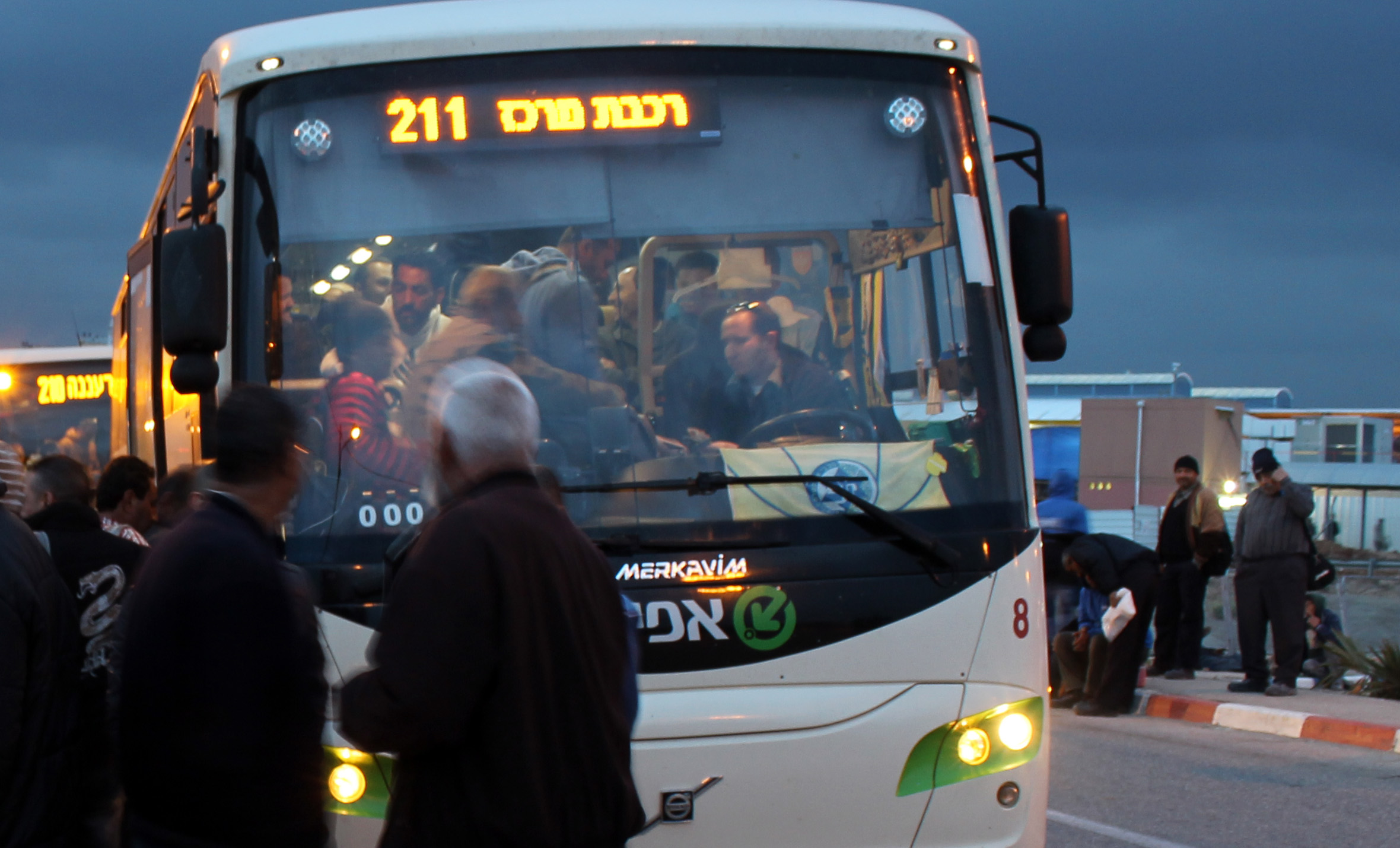 20130305 - Palestinian workers in front of bus.jpg
