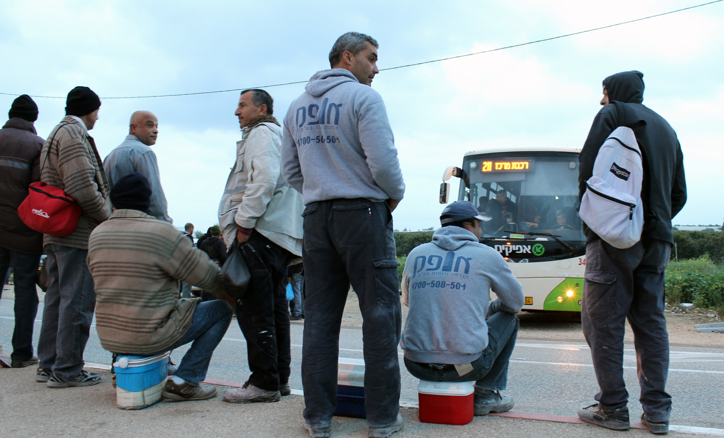 20130305 - Palestinian workers wait for bus.jpg