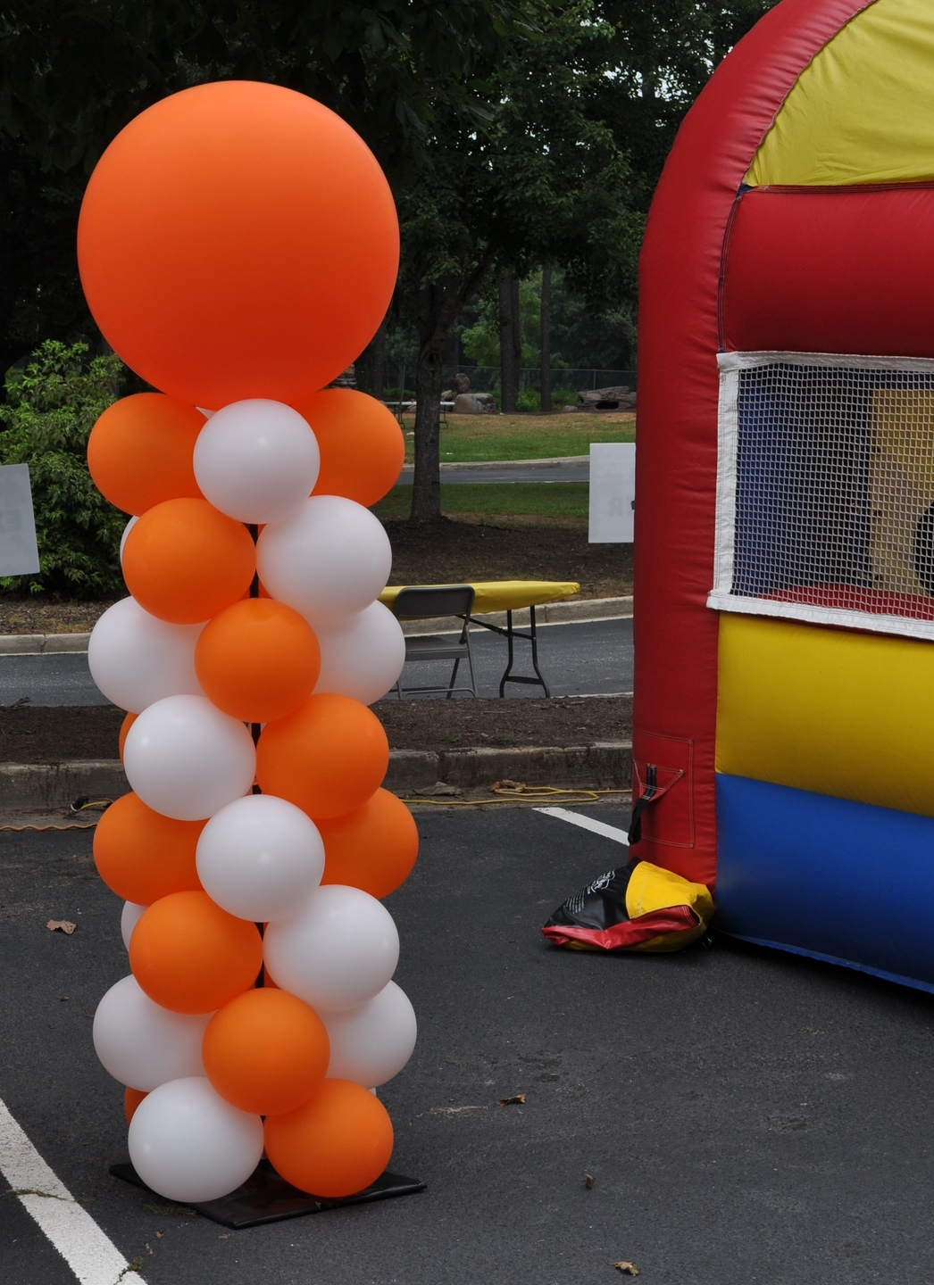 Orange and white outdoor balloon column