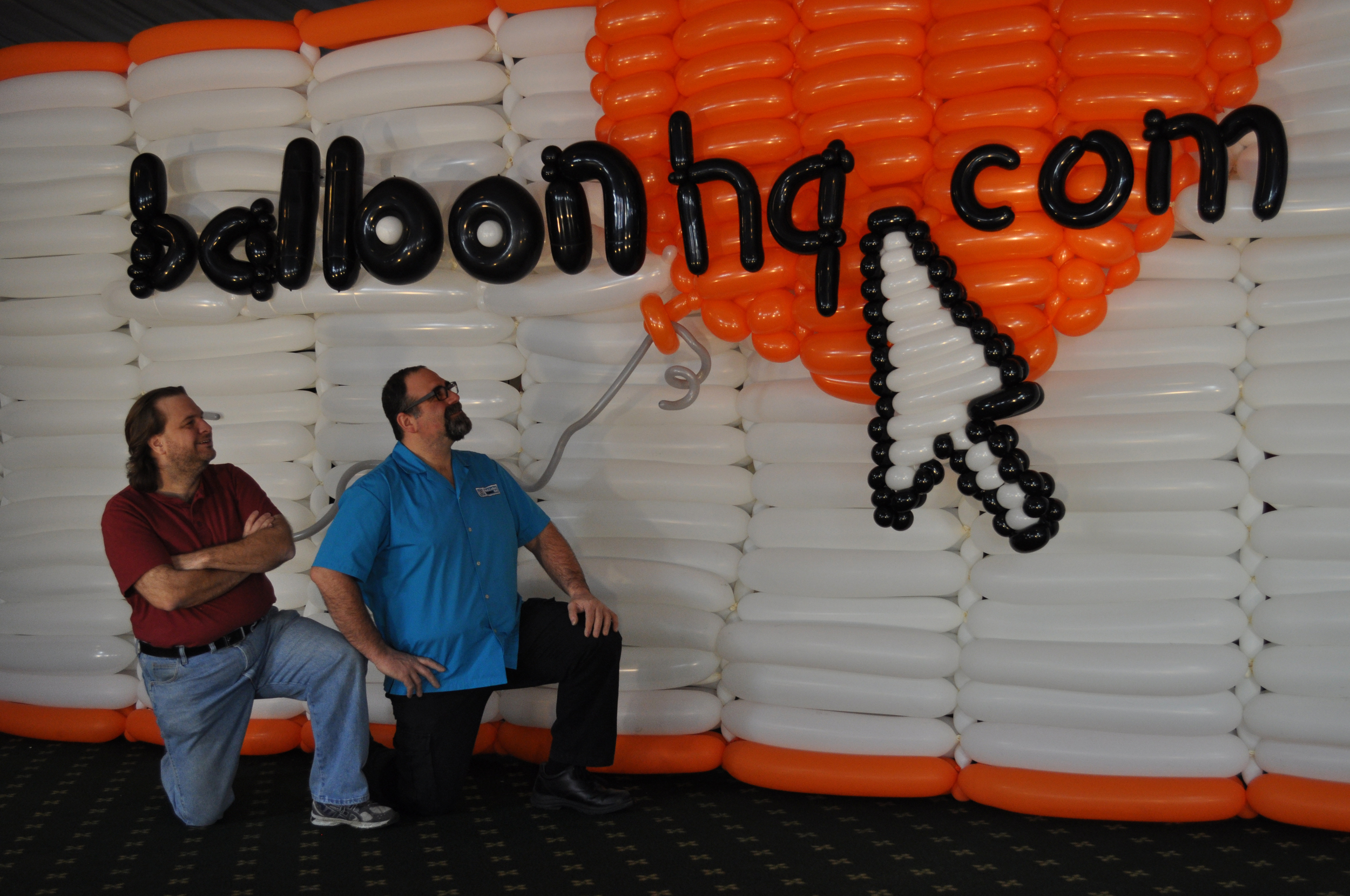 """Balloon artist Brian Asman and myself. Brian designeda giant balloon version of the """"balloonhq.com"""" logo; and it was a blast being a part of the crew that built it!Brian was a star ofthe TLC program """"The Unpoppables""""."""